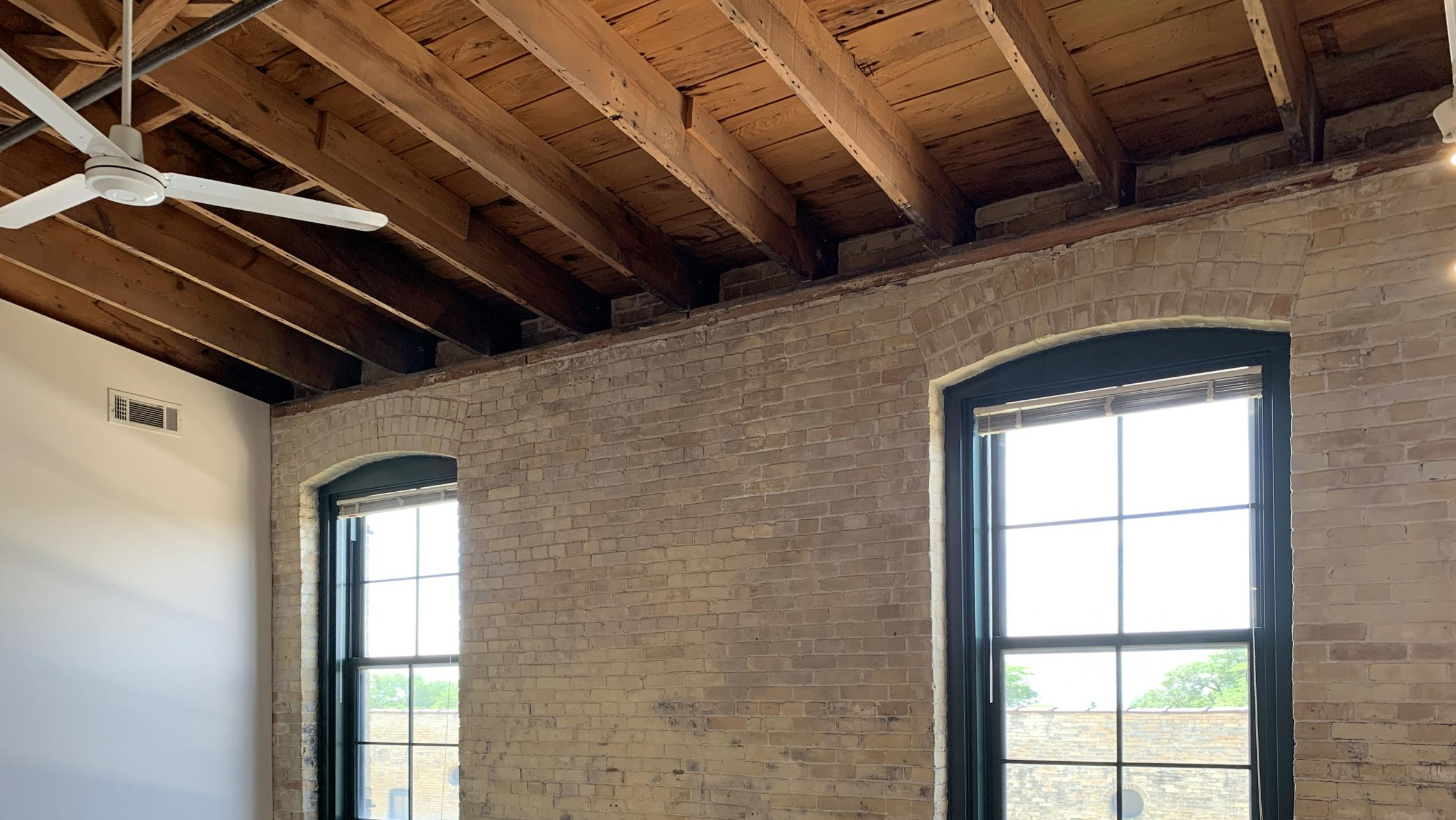 Tobacco-Lofts-at-The-Yards-Apartment-E310-One-Bedroom-Historic-Exposed-Brick-Timber-Beams-Unique-Design-Cats-High-Ceiling-Balcony-Downtown-Madison-Fitness-Lounge-Courtyard-Top-Floor-Vaulted-Ceiling