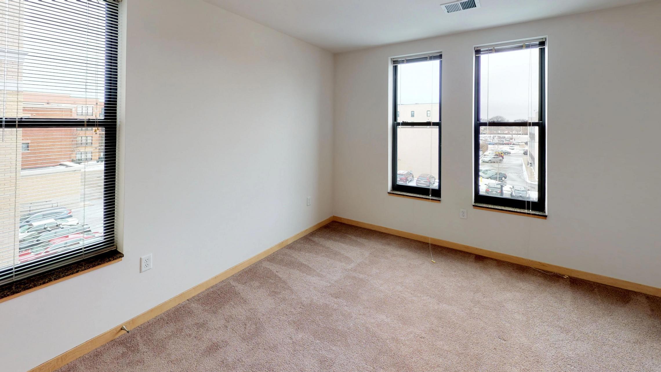 The-Depot-Apartments-Downtown-Madison-Lifestyle-Large-Closet-Bike-Storage-Washington-Ave-Style-Design-Balcony-Apartment-1-316-One-Bedroom-Den