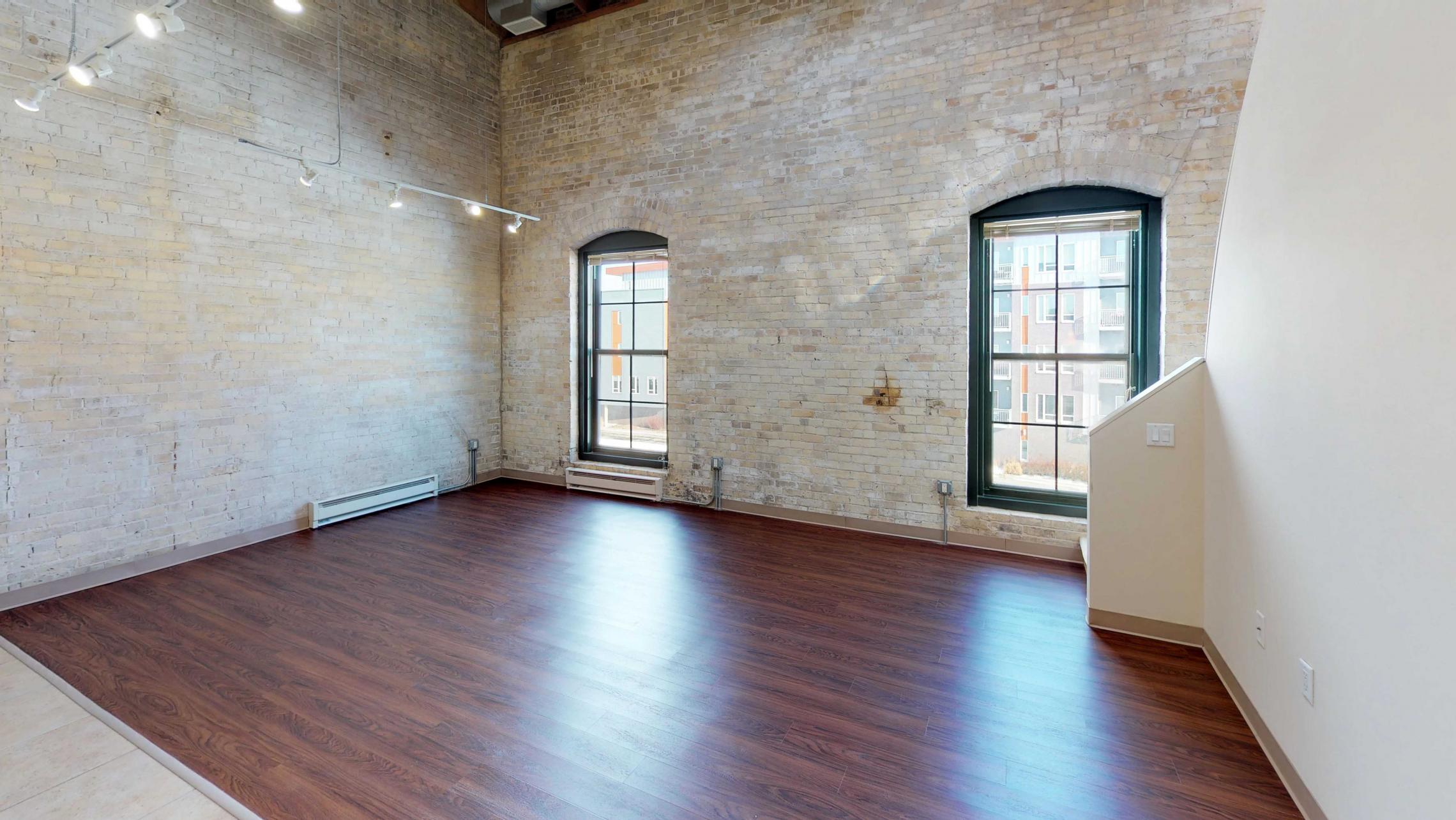 Tobacco-Lofts-Apartment-E307-Historic-Downtown-Lofted-Two-Bedroom-Madison-Exposed-Brick-Design-Beams-Dining