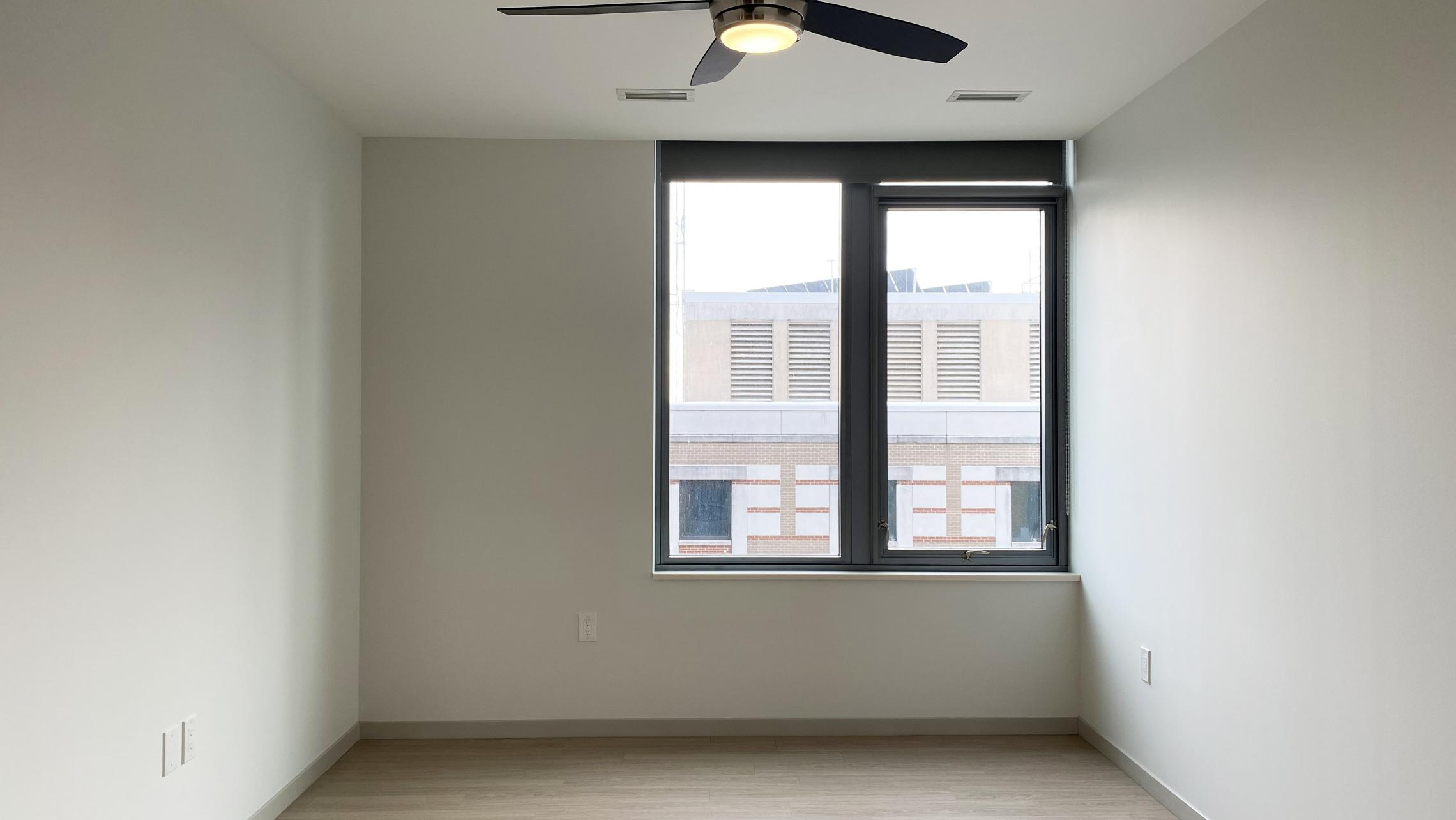 The-Pressman-Apartment-411-One-Bedroom-One-Bath-Kitchen-Living-Upscale-Luxurious-Modern-Exposed-Duct-Concrete-Capitol-Square-Downtown-Madison-Balcony-Terrace-Pets-Fitness-Lounge-Grill-Lifestyle