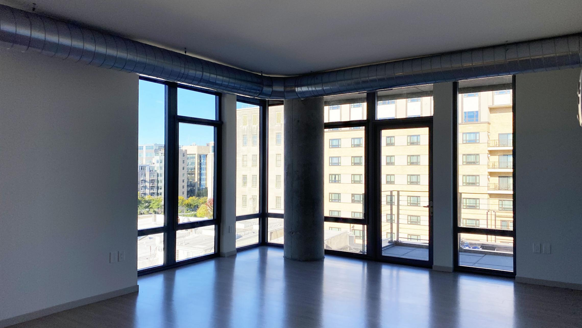 The-Pressman-Apartment-602-Two-Bedroom-Two-Bath-Kitchen-Living-Upscale-Luxurious-Modern-Exposed-Duct-Concrete-Capitol-Square-Downtown-Views-Madison-Balcony-Terrace-Pets-Fitness-Lounge-Grill-Lifestyle