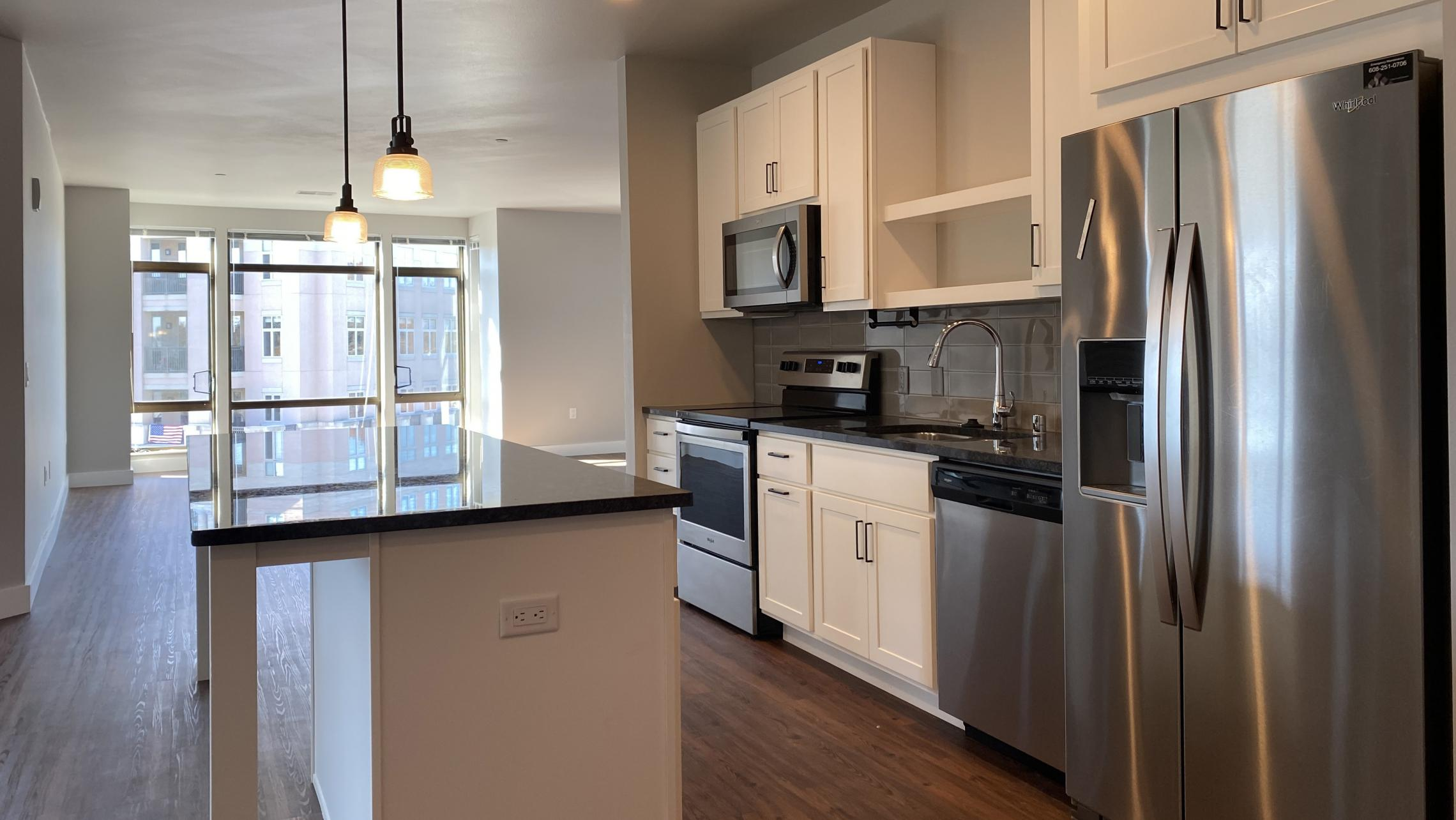 1722-Monroe-Apartments-419-Three-Bedroom-Modern-Upscale-Design-Windows-Natural-Light-Gym-Terrace-Living-Luxury-Lounge-Madison-Kitchen