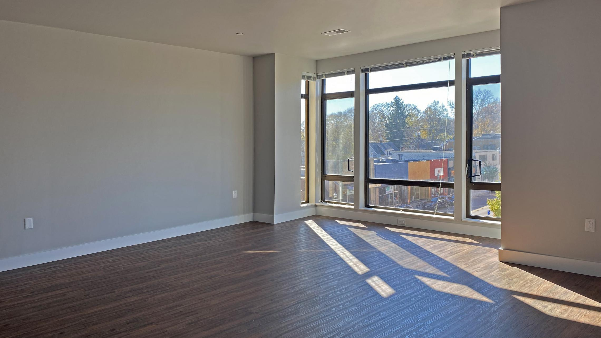 1722-Monroe-Apartments-419-Three-Bedroom-Modern-Upscale-Design-Windows-Natural-Light-Gym-Terrace-Living-Luxury-Lounge-Madison-Living-Space-Entertaining-View