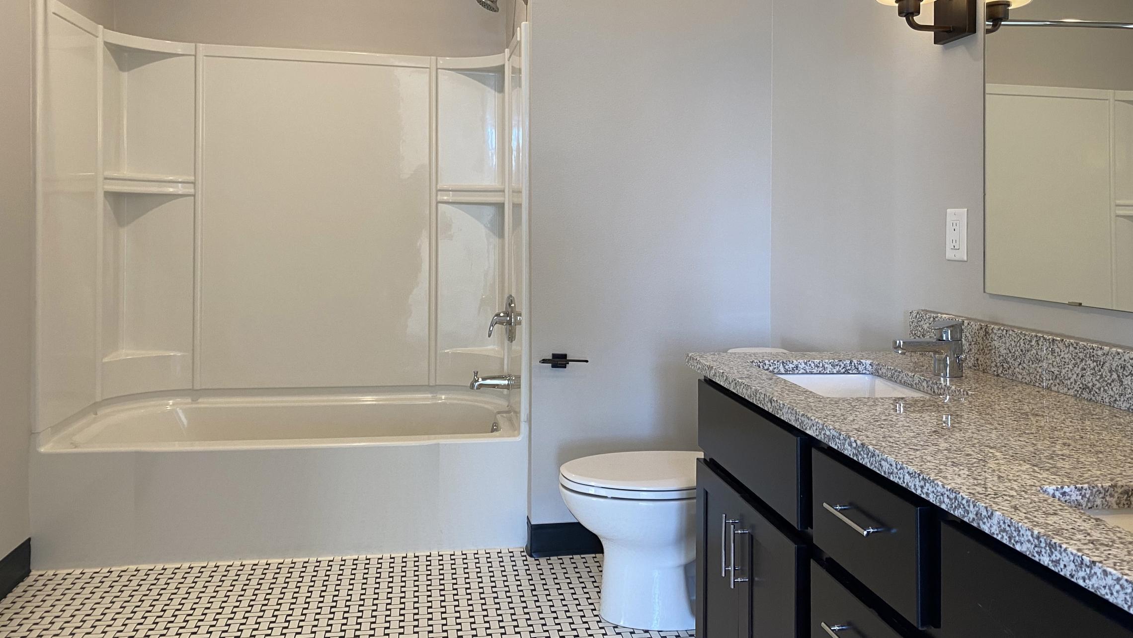 1722-Monroe-Apartments-419-Three-Bedroom-Modern-Upscale-Design-Windows-Natural-Light-Gym-Terrace-Living-Luxury-Lounge-Madison-Bathroom-Vanity-Soaking-Tub