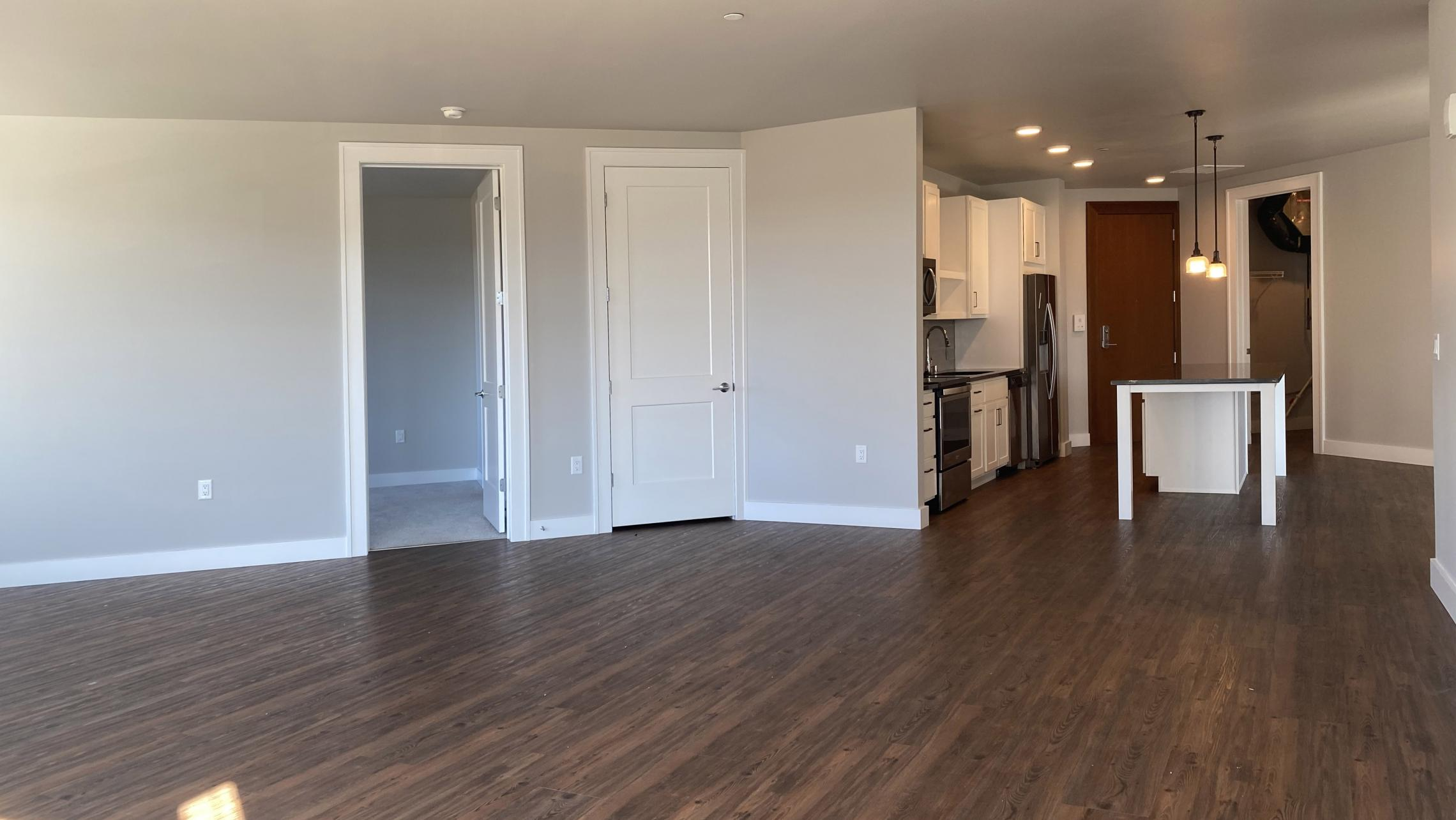 1722-Monroe-Apartments-419-Three-Bedroom-Modern-Upscale-Design-Windows-Natural-Light-Gym-Terrace-Living-Luxury-Lounge-Madison-Living-Space-Kitchen