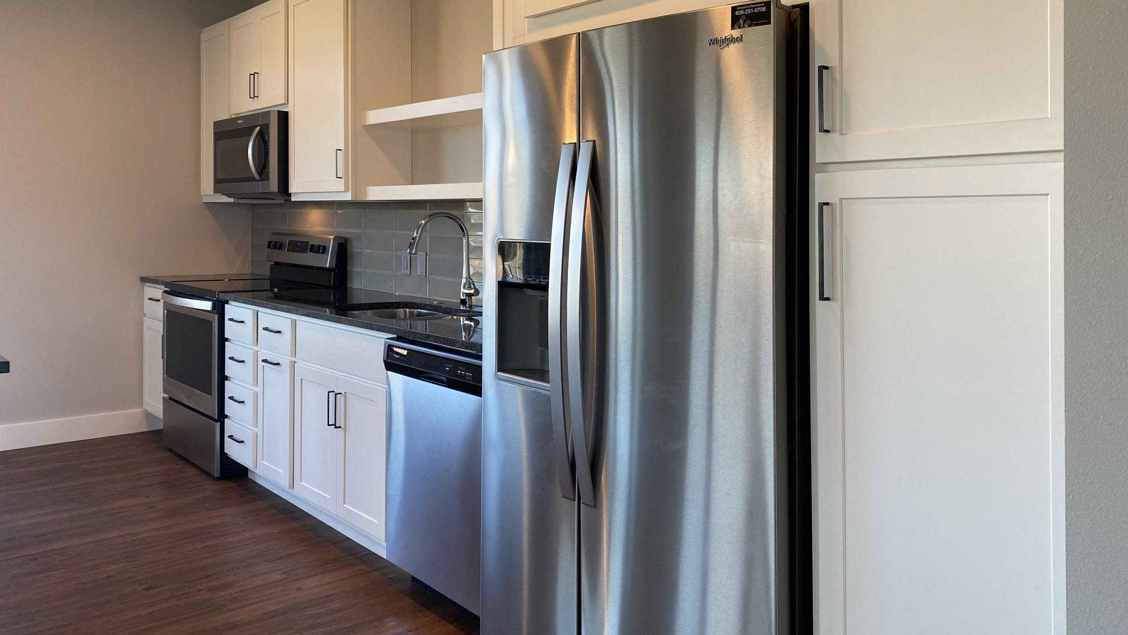 1722-Monroe-Apartments-320-Three-Bedroom-Modern-Upscale-Design-Windows-Natural-Light-Balcony-Gym-Terrace-Living-Luxury-Lounge-Madison-Views-Kitchen
