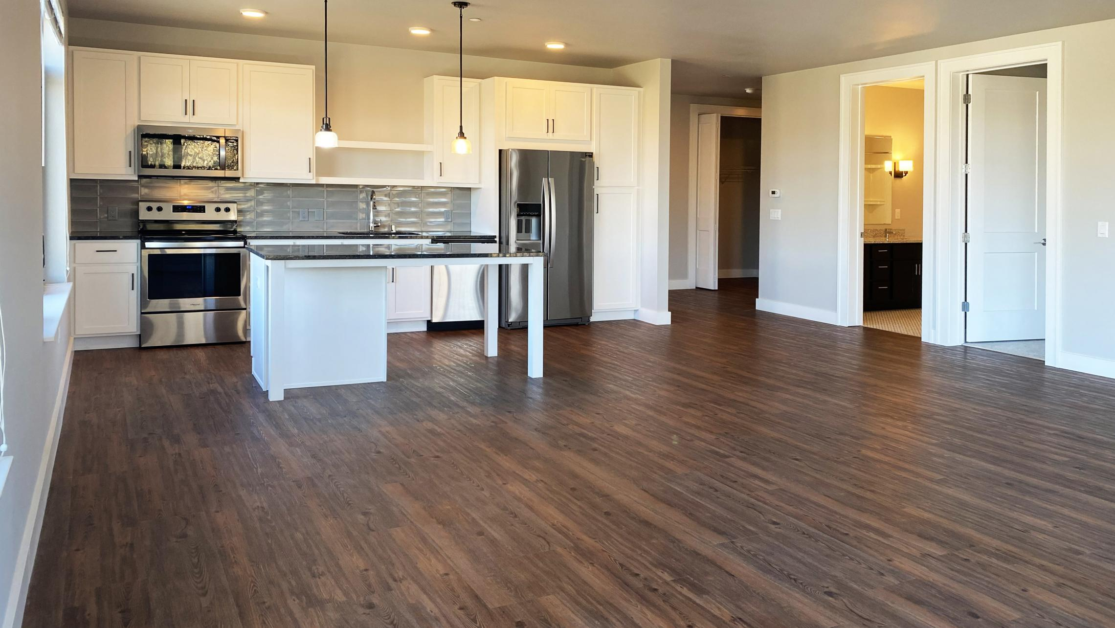 1722-Monroe-Apartments-320-Three-Bedroom-Modern-Upscale-Design-Windows-Natural-Light-Balcony-Gym-Terrace-Living-Luxury-Lounge-Madison-Views-Living-Space-Kitchen
