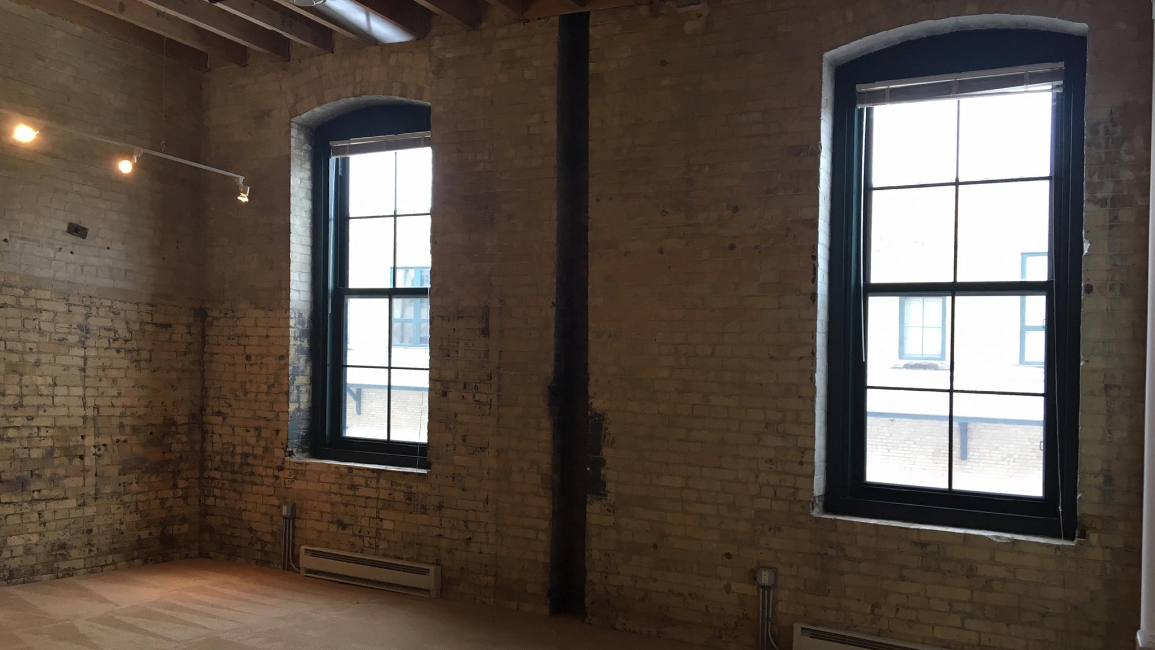 Tobacco-Lofts-At-The-Yards-Apartment-E208-One-Bedroom-Historic-Exposed-Brick-Timber-Unique-Downtown-Madison-Bike-Path-Fitness-Lounge-Courtyard