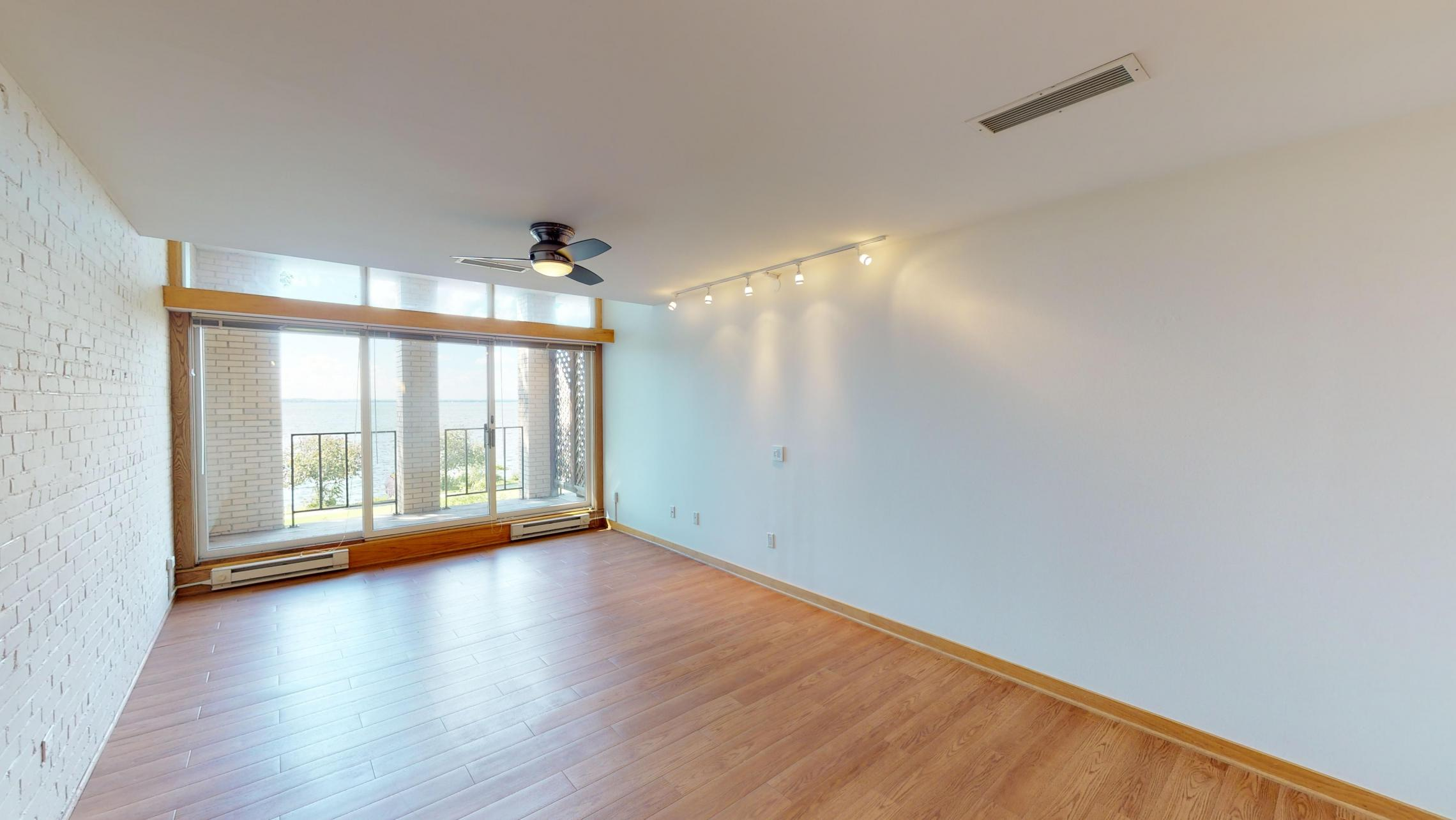 ULI-Lincoln-School-Apartment-205-One-Bedroom-Den-Living-Area-Historic-Apartment-Lake-View-Downtown-Terrace-Balcony-Home-Trails-Parks