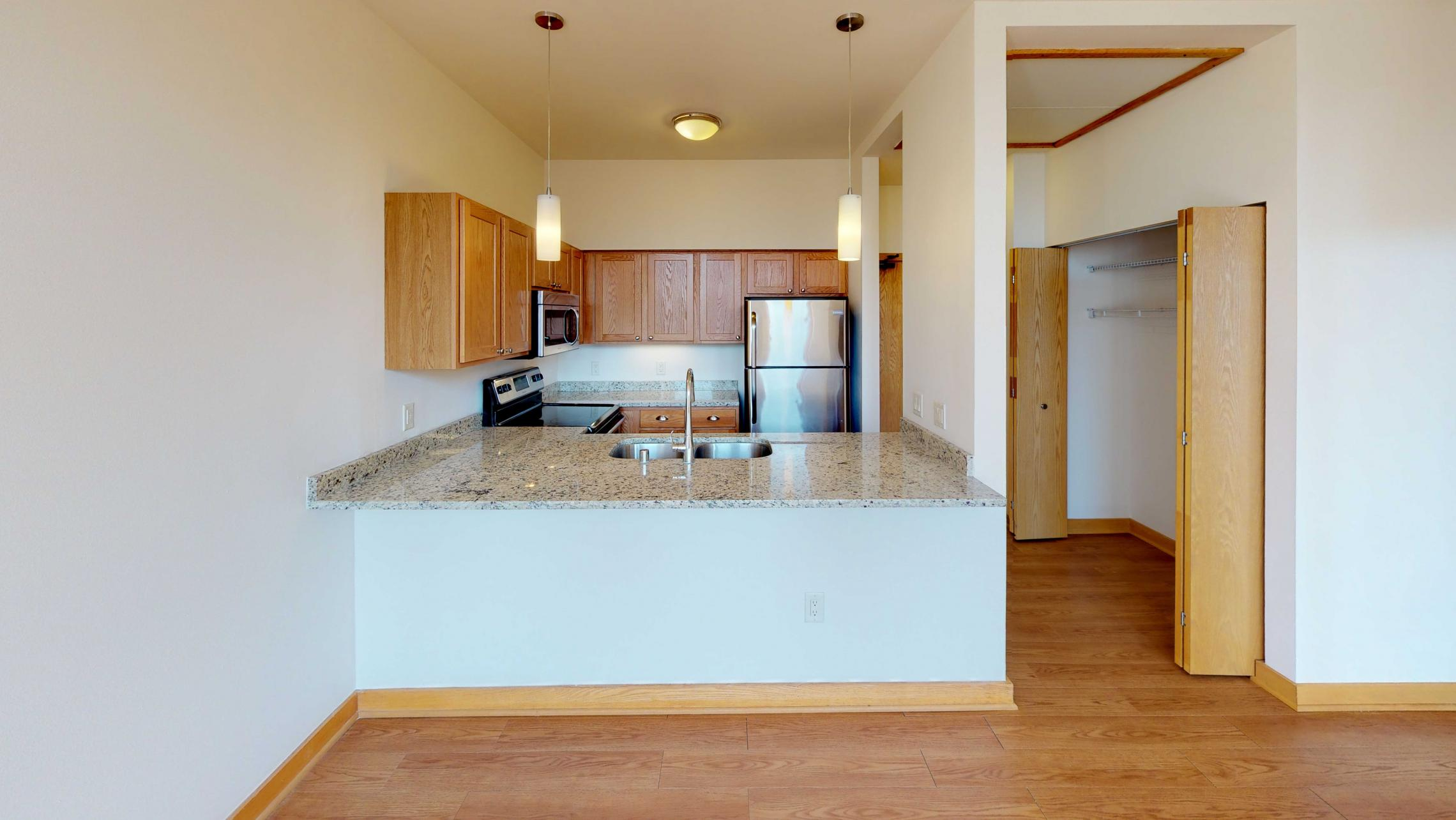 ULI-Lincoln-School-Apartment-406-One-Bedroom-Living-Area-Kitchen-Historic-Apartment-Downtown-View-Pet-Friendly-Dogs-Cats-Level-Home-Trails-Parks