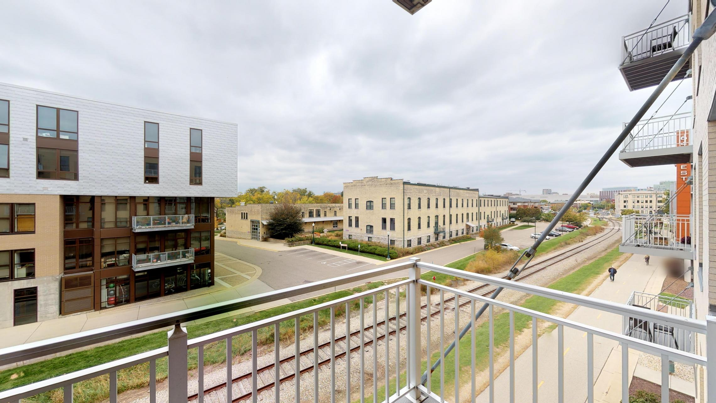 Nine-Line-Apartment-316-Kitchen- Living-Upsclale-Modern-Downtown-Madison-One-Bedroom-Balcony-View-Bike-Path-Monona-Bay-Fitness-Design-Bathroom