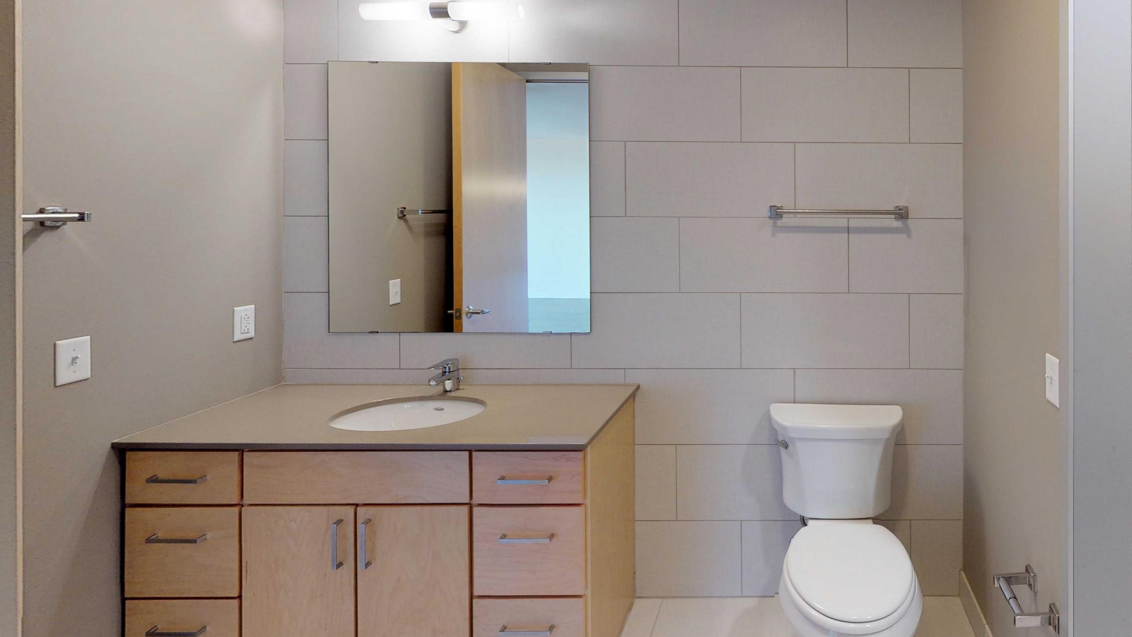 Nine-Line-Apartment-517-Modern-Bathroom-Details-Madison-Upscale-Views-Downtown.jpg