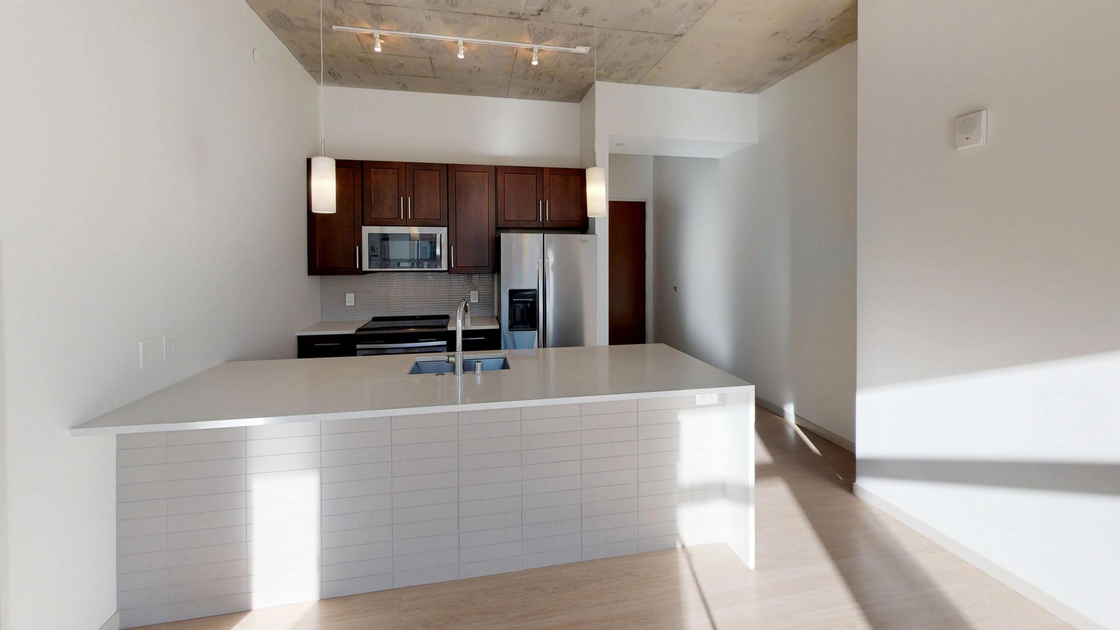 Pressman-211-Apartment-One-Bedroom-Luxury-Modern-Upscale-Downtown-Capitol-Concrete-Madison-Kitchen-Island-Living-Space-Sunny-Natural-Light