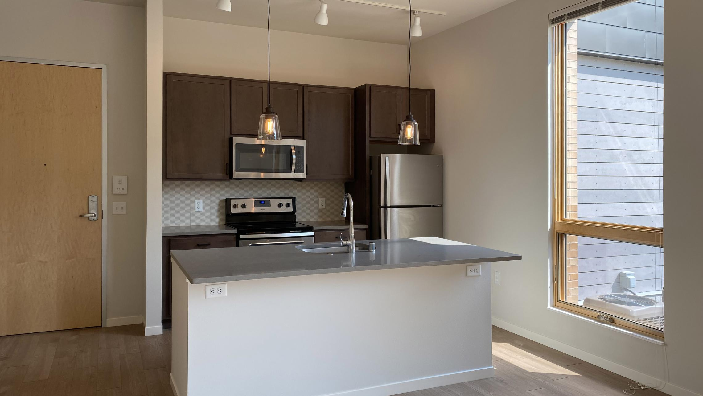 Quarter-Row-The-Yards-Apartment-102-Croner-Balcony-Downtown-Madison-Bike-Cat-Dog-Lifestule-Modern-Upscale-Design-Living-Kitchen-Island