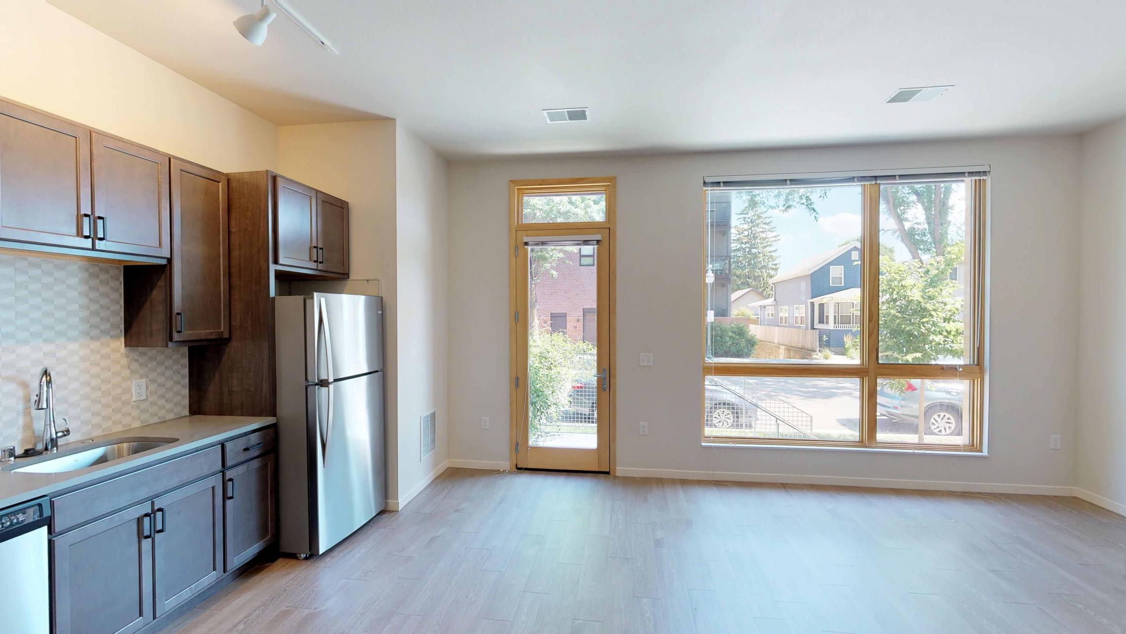 Quarter-Row-Apartments-Downtown-Madison-Capitol-Lake-Views-Balcony-Sun-Terrace-Courtyard-Fireplace-Dogs-Cats-Modern-Upscale-Apartment-109-One-Bedroom-Walk-Up