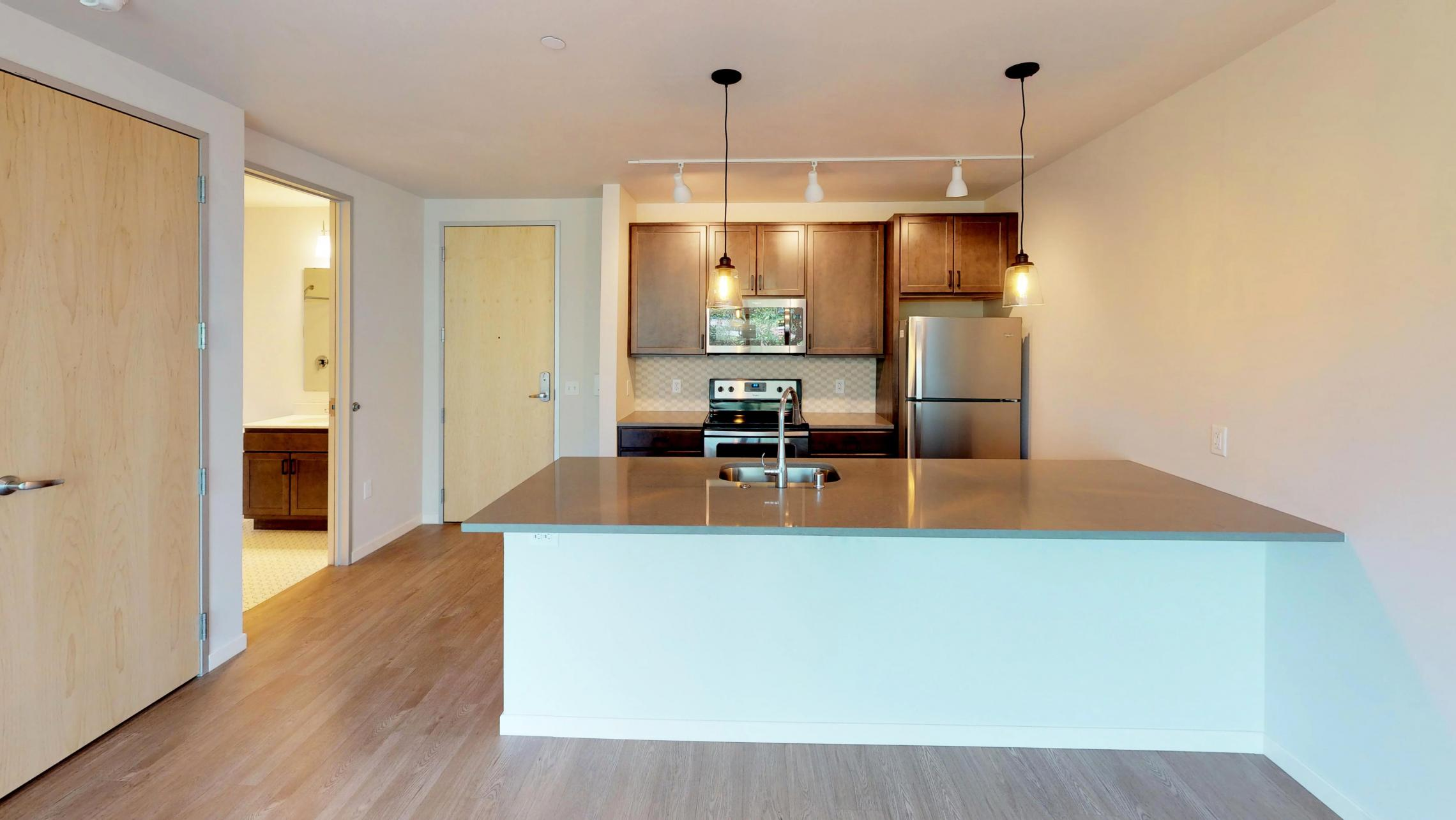Quarter-Row-Apartments-Downtown-Madison-Modern-Luxury-Lake-Capitol-Views-Fitness-Terrace-Grill-Fireplace-Amenities-Apartment-One-Bedroom-Top-Floor