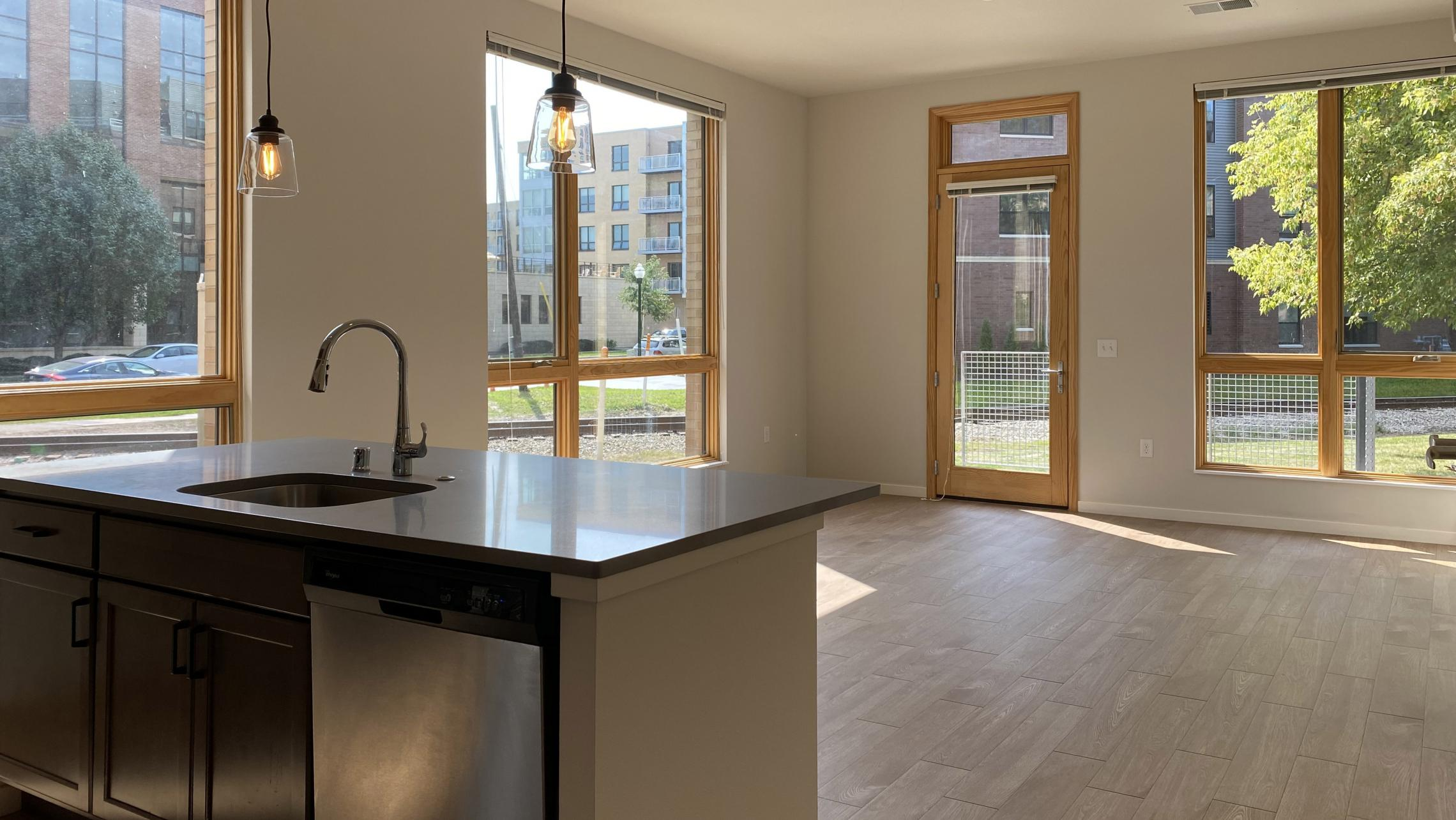 Quarter-Row-The-Yards-Apartment-102-Corner-Balcony-Downtown-Madison-Bike-Cat-Dog-Lifestule-Modern-Upscale-Design-Living-Kitchen.jpg
