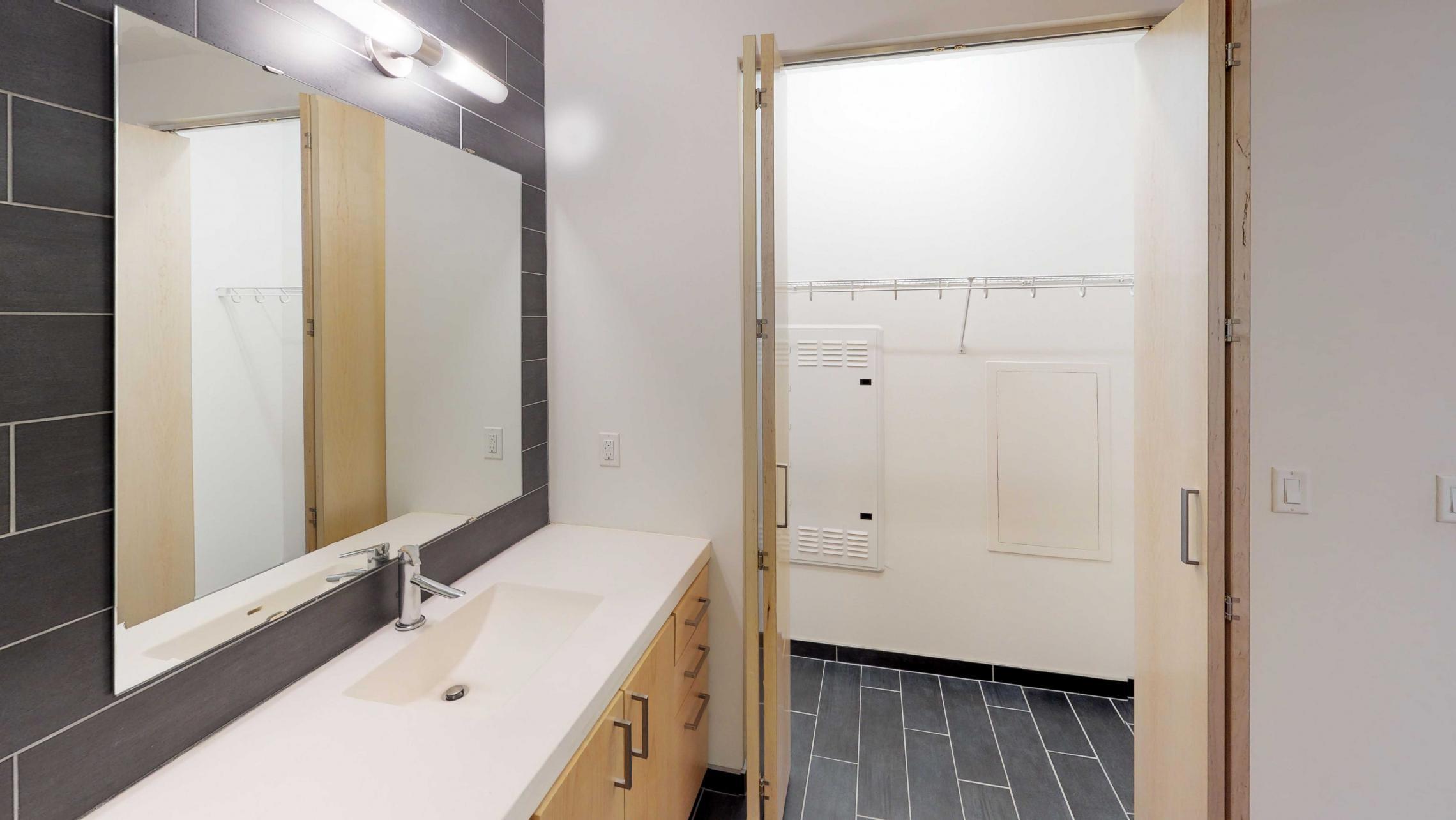 SEVEN27-Apartment-115-studio-lake view-modern-upscale-downtown-madison-patio-courtyard-bathroom-closet-storage.jpg