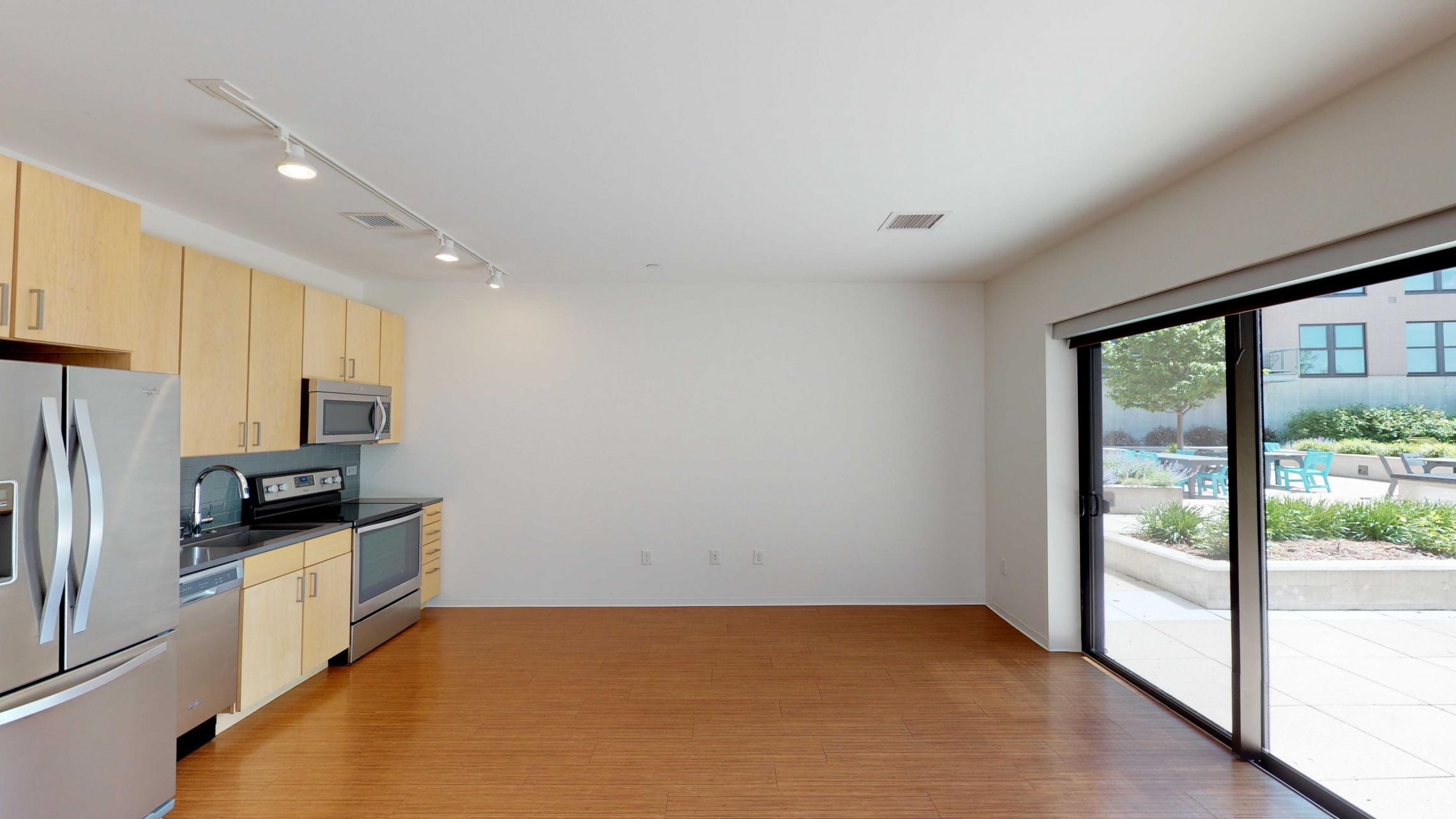 SEVEN27-Apartment-115-studio-lake view-modern-upscale-downtown-madison-patio-courtyard-living room-kitchen.-lifestyle.jpg