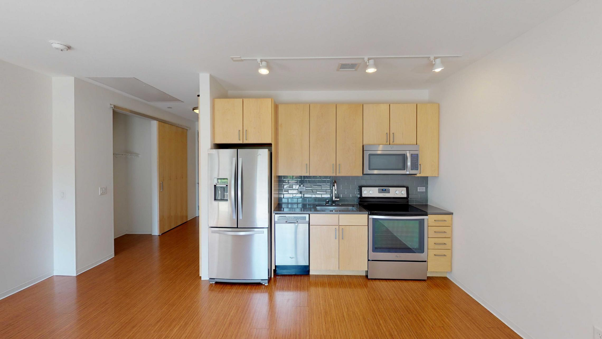 SEVEN27-Apartment-115-studio-lake view-modern-upscale-downtown-madison-patio-courtyard-living room-kitchen.jpg