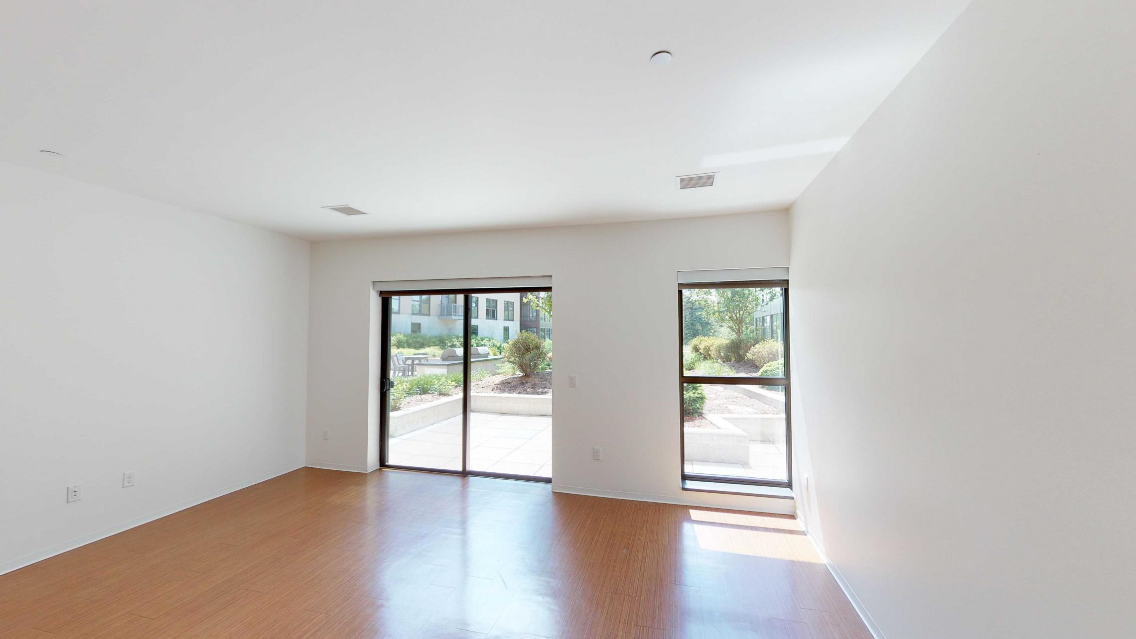 SEVEN27-Apartment-115-studio-lake view-modern-upscale-downtown-madison-patio-courtyard-living space.jpg