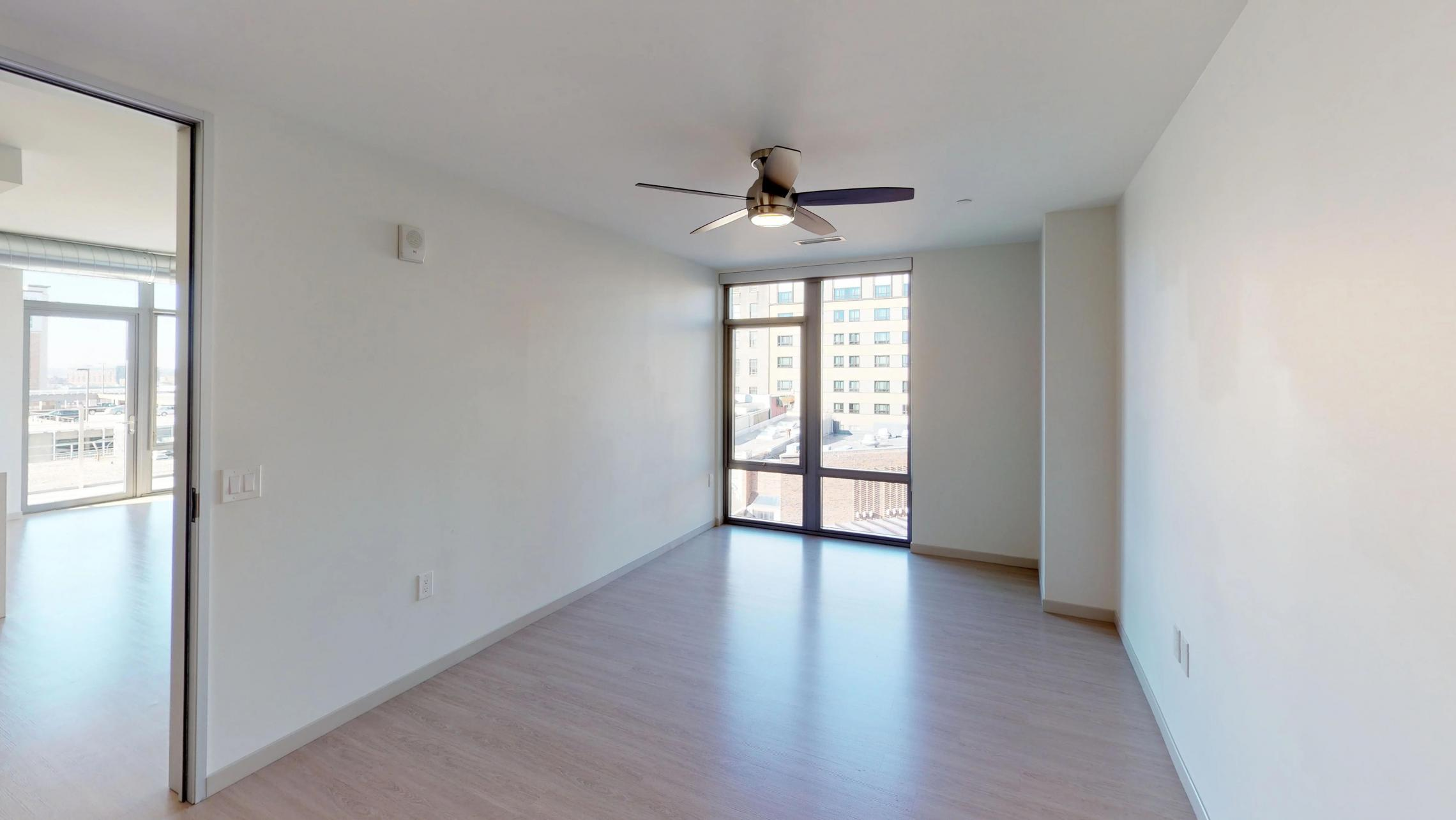 The-Pressman-Apartment-512-Two-Bedroom-Living-Room-View-Kitchen-Island-Downtown-Madison-Capitol-Balcony-Master-Bedroom.jpg