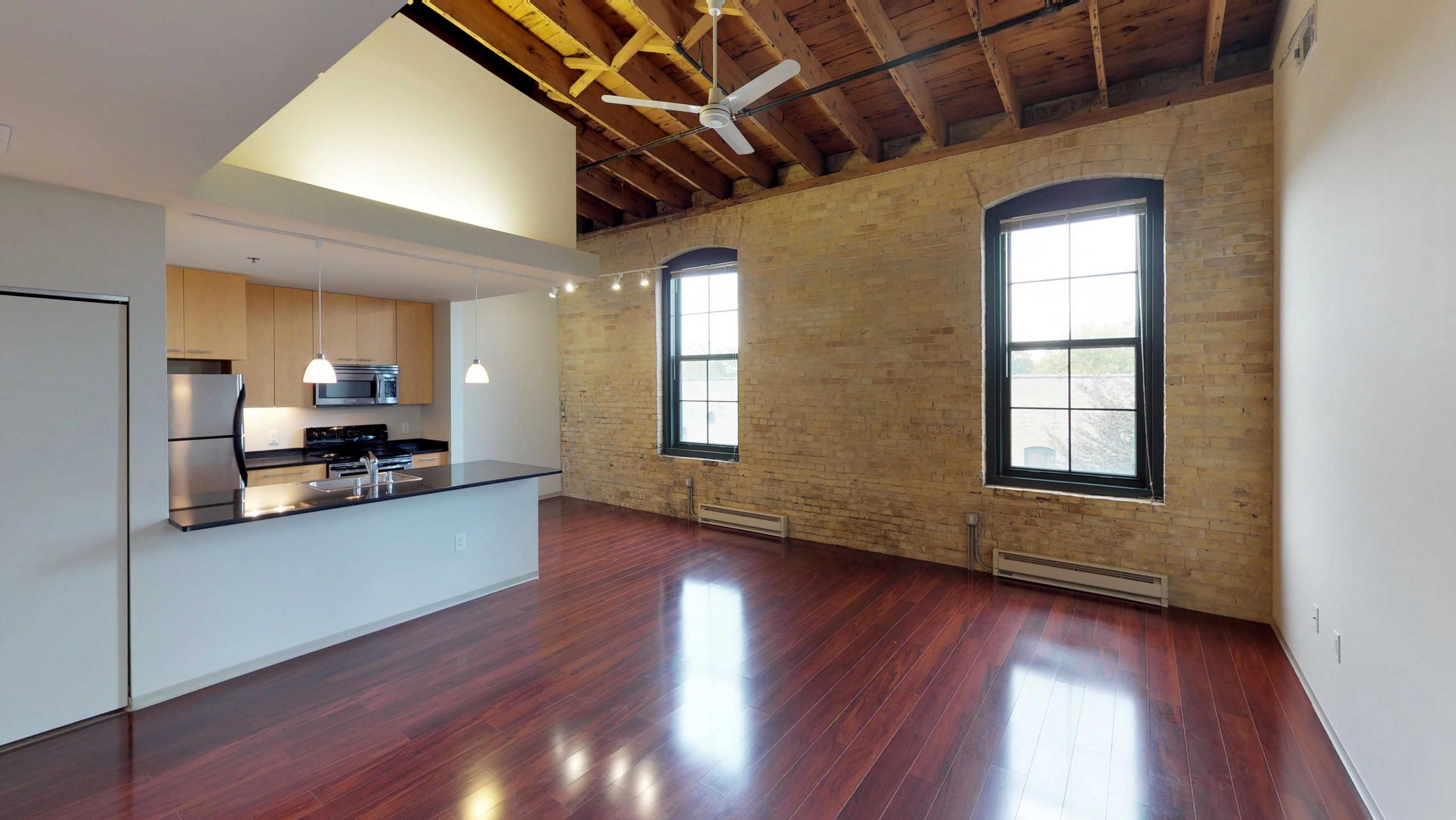 Tobacco-Lofts-Apartment-E312-Historic-Downtown-Two-Bedroom-Madison-Exposures-Brick-Vaulted-Ceiling-Yards.jpg