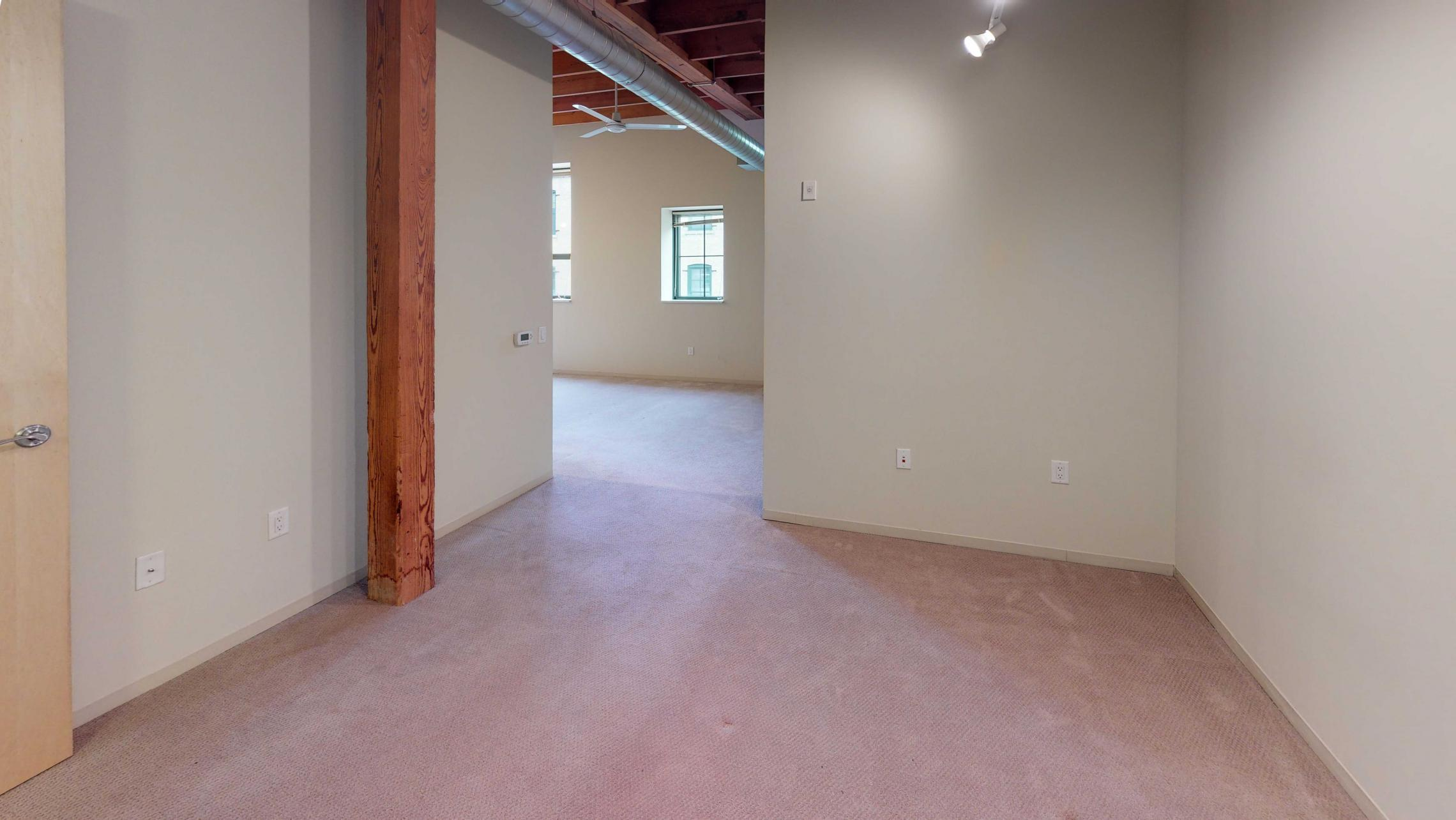 Tobacco-Lofts-Apartment-W219-Studio-Downtown-Madison-Historic-Brick-Exposures-Living-Room-Yards-Bedroom.jpg
