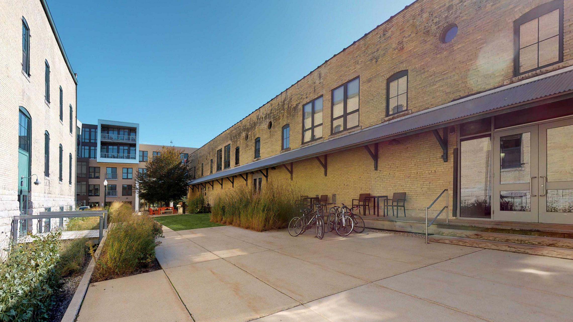 Tobacco-Lofts-Courtyard-Historic-Apartments-Design-Brick-Downtown-Madison-Yards-Boccie-Grill-Bike