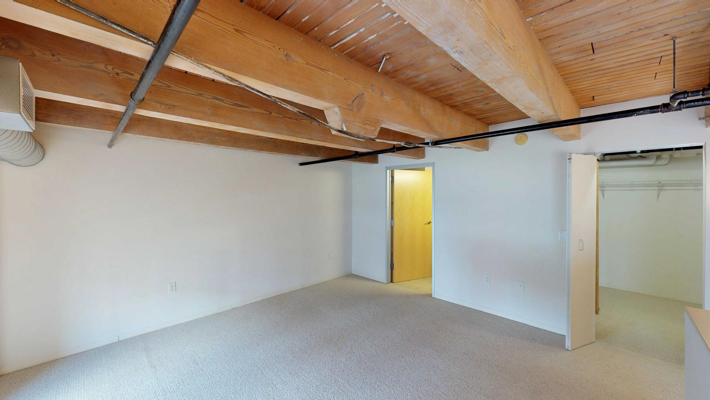 Tobacco-Lofts-E203-Historic-Two-bedroom-lofted-design-exposed-brick-downtown