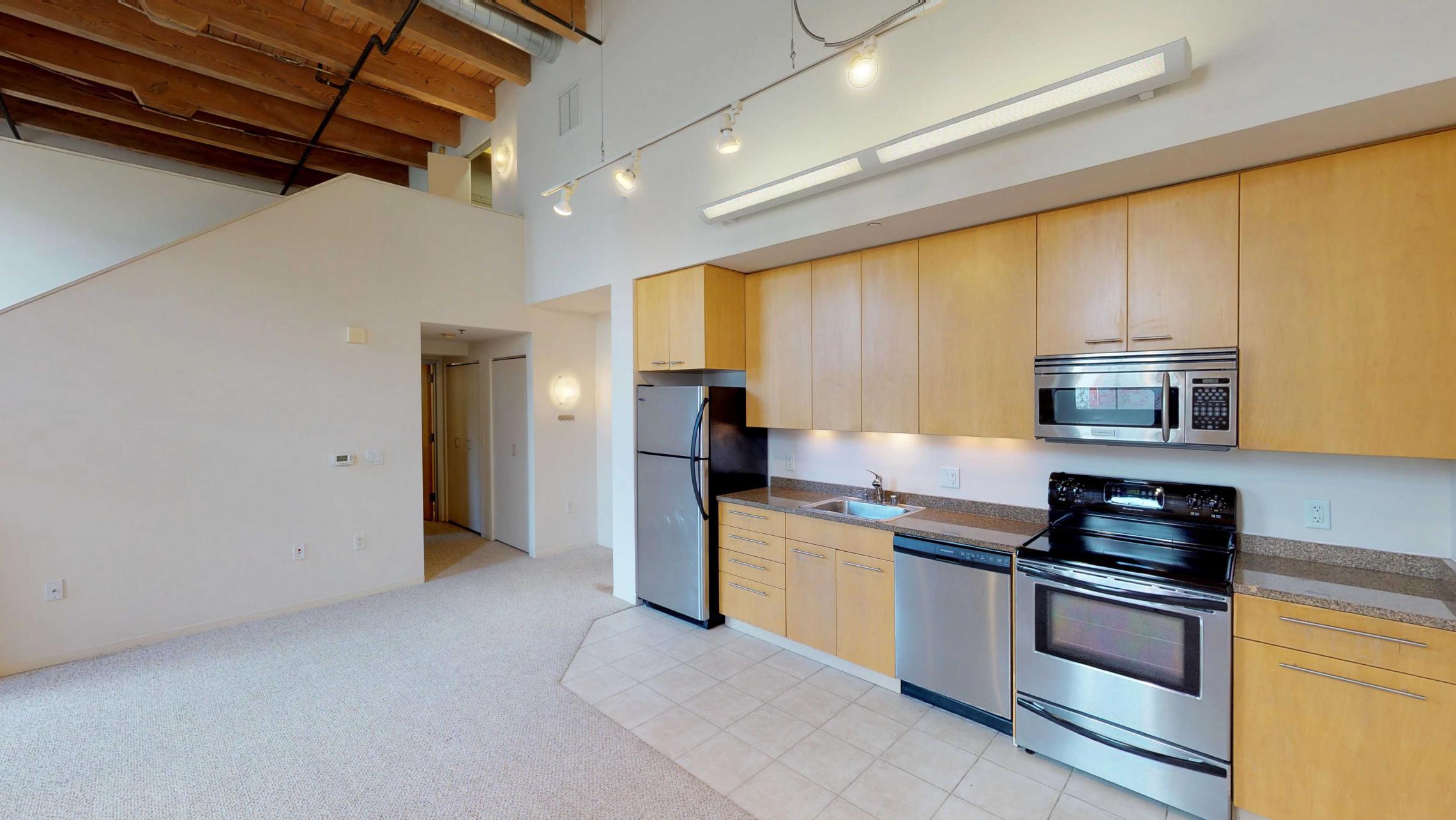 Tobacco-Lofts-E203-lofted-two-bedroom-exposed-brick-upscale-design-historic