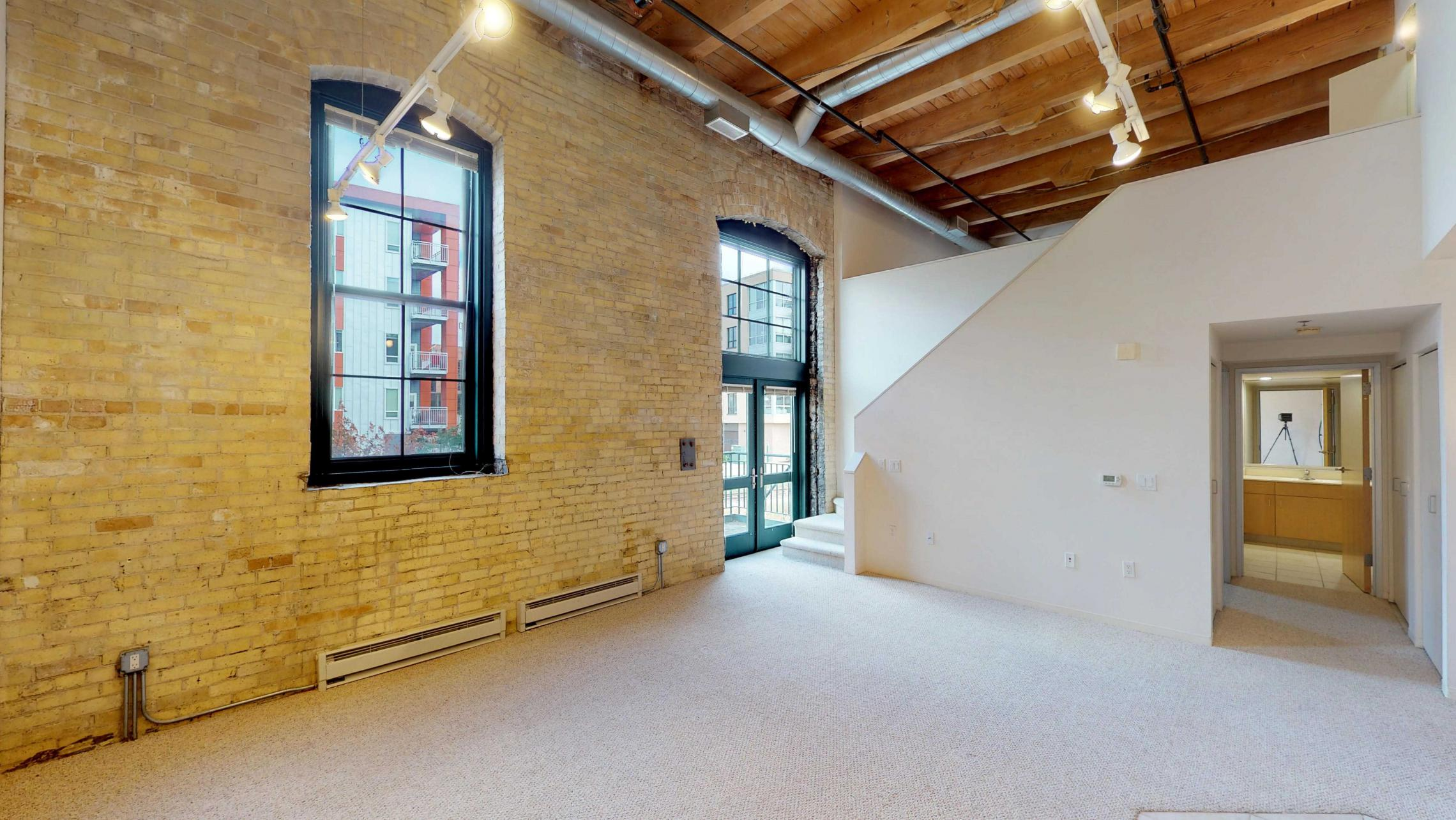 Tobacco-Lofts-E203-lofted-two-bedroom-exposed-brick-upscale-design-historic