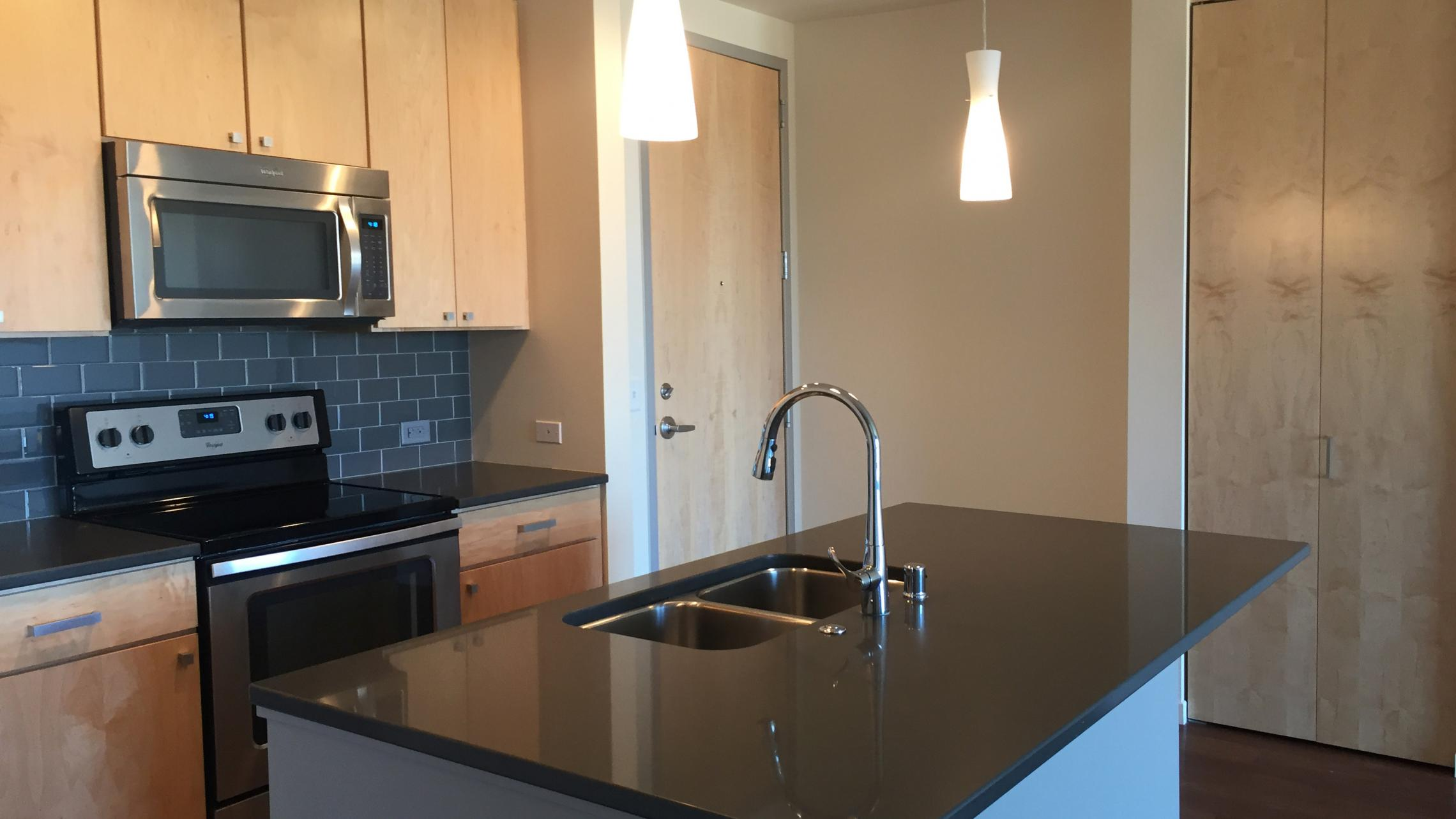 ULI Nine Line Apartment 216 - Kitchen with Stainless Steel Appliances