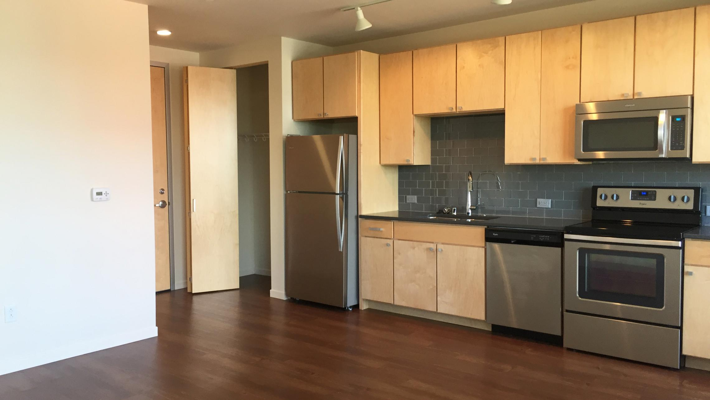 ULI Nine Line Apartment 412 - Kitchen with Stainless Steel Appliances