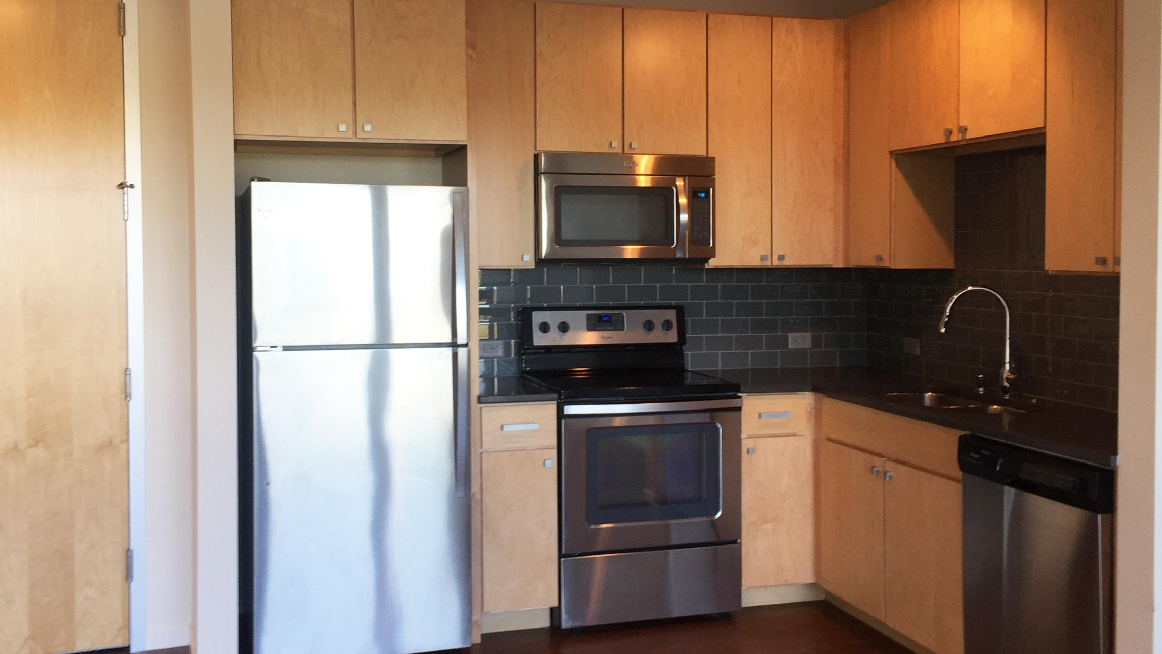 ULI Nine Line Apartment 509 - Kitchen with Stainless Steel Appliances