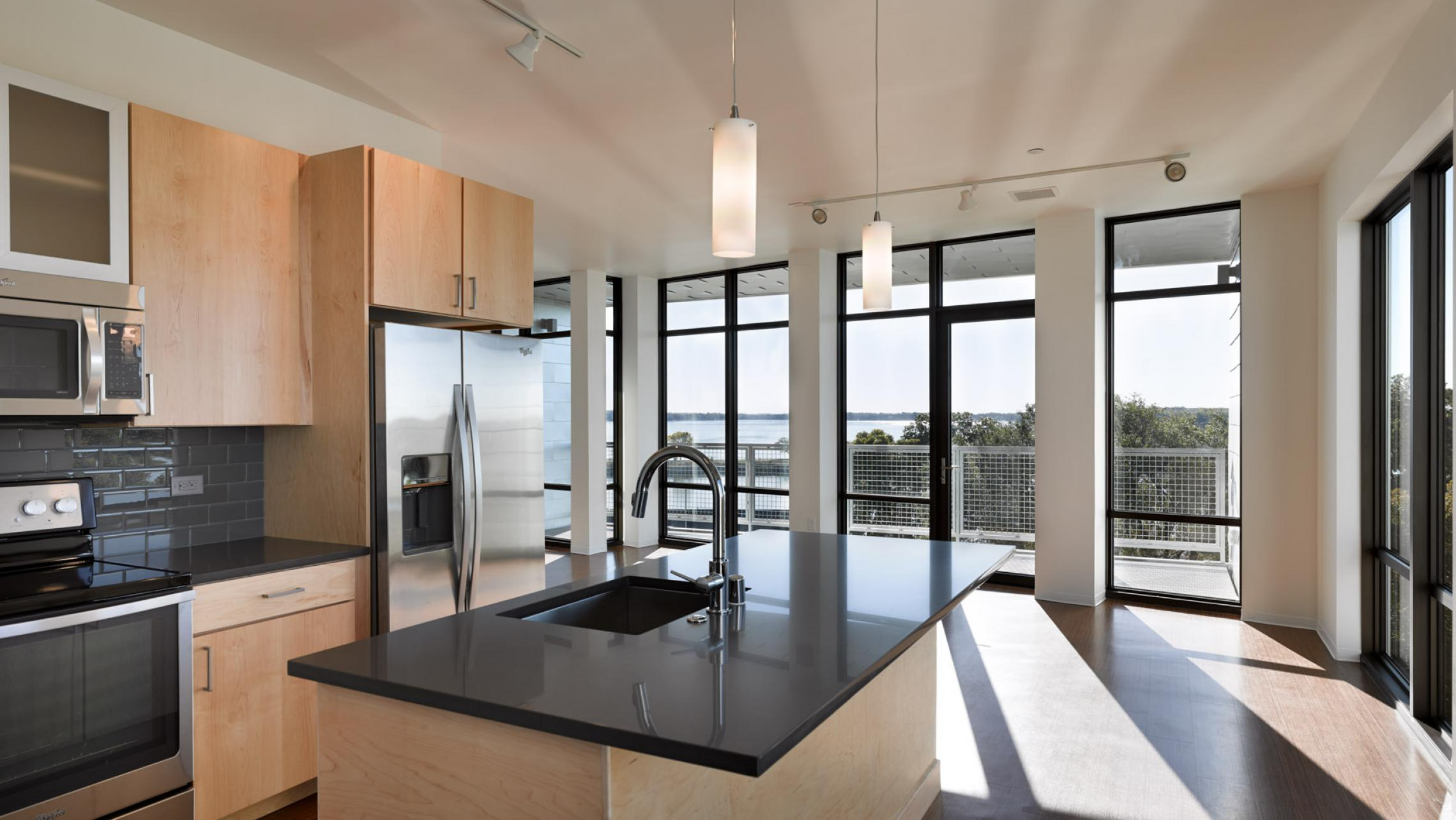 ULI Seven27 Apartments - Kitchen with a lake view and natural light
