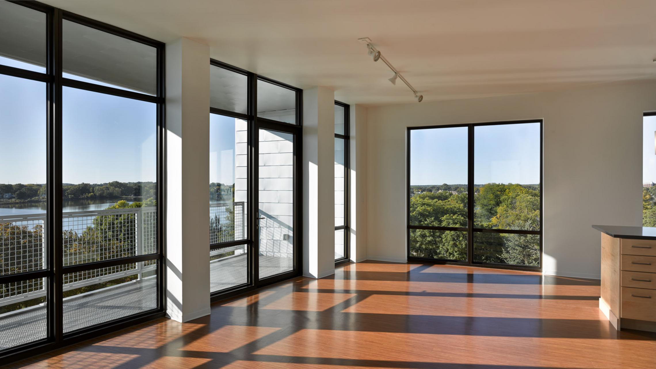 ULI Seven27 Apartments - Living room with lake view and direct sunlight