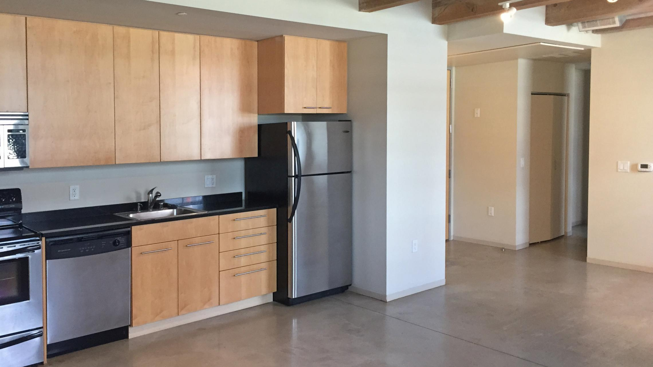 ULI Tobacco Lofts - E105 - Kitchen with Exposed Wood Beams