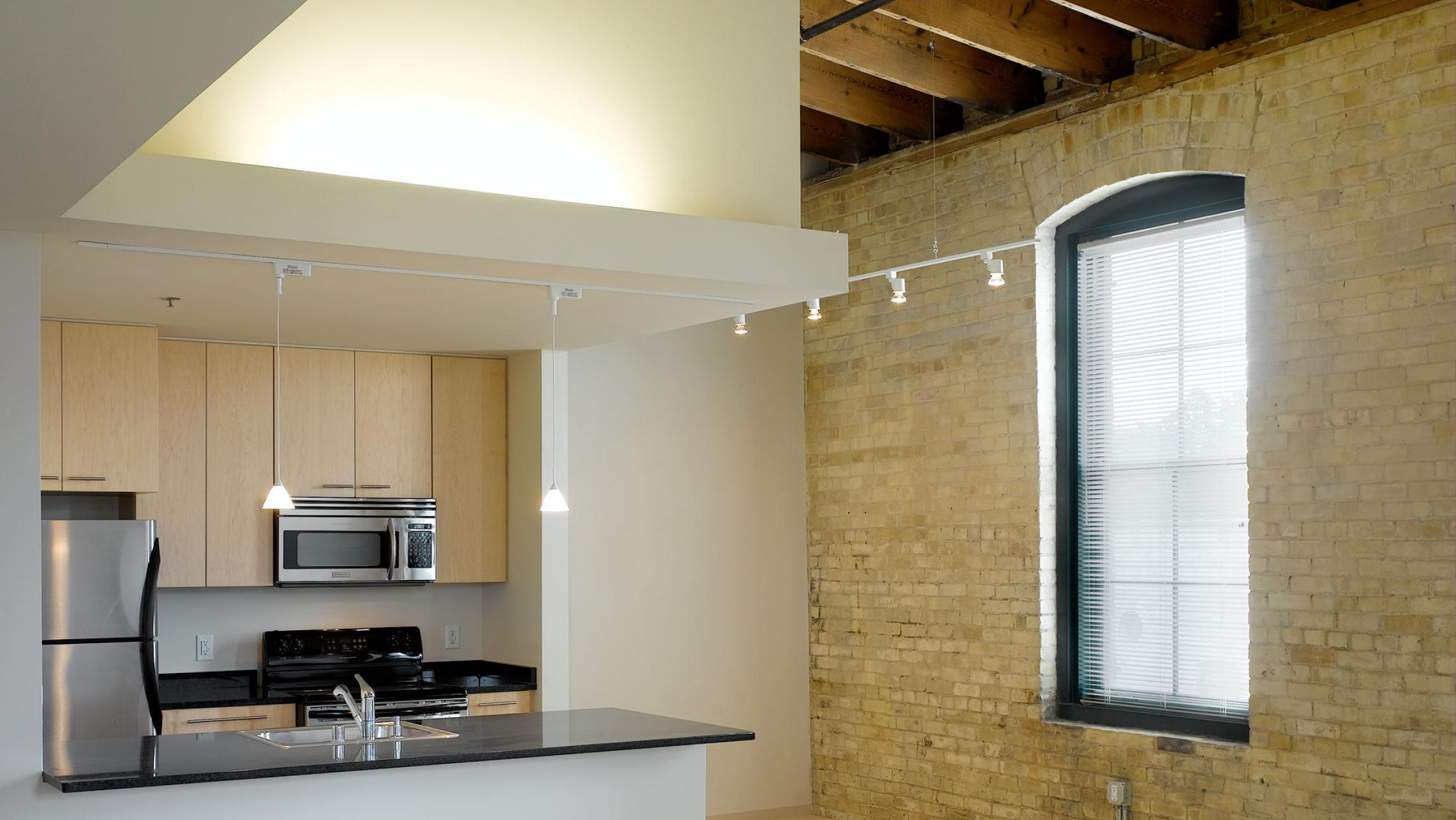 ULI Tobacco Loft Apartments - Kitchen with Exposed Brick