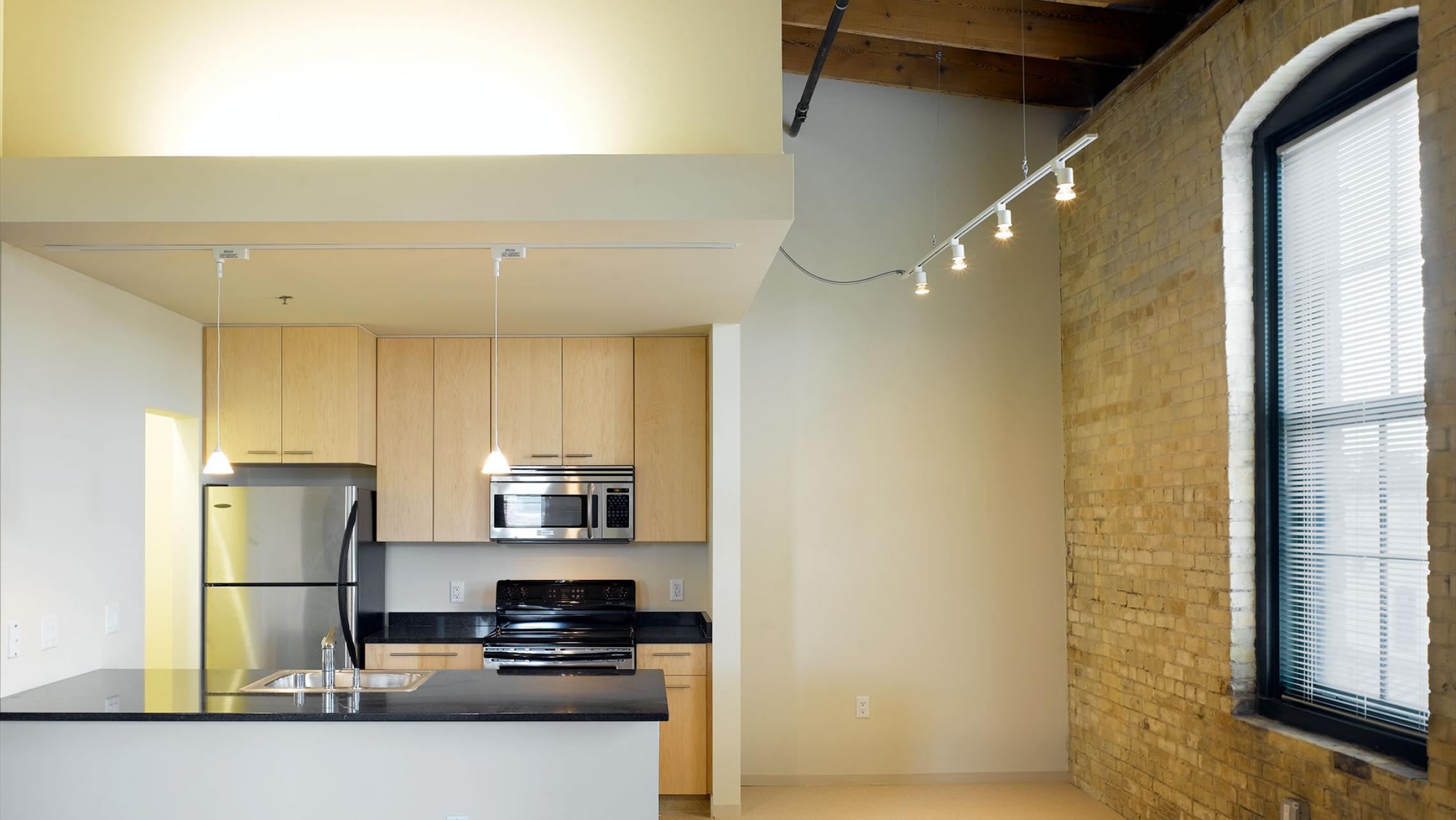 ULI Tobacco Loft Apartments - Kitchen Living Area with Exposed Brick