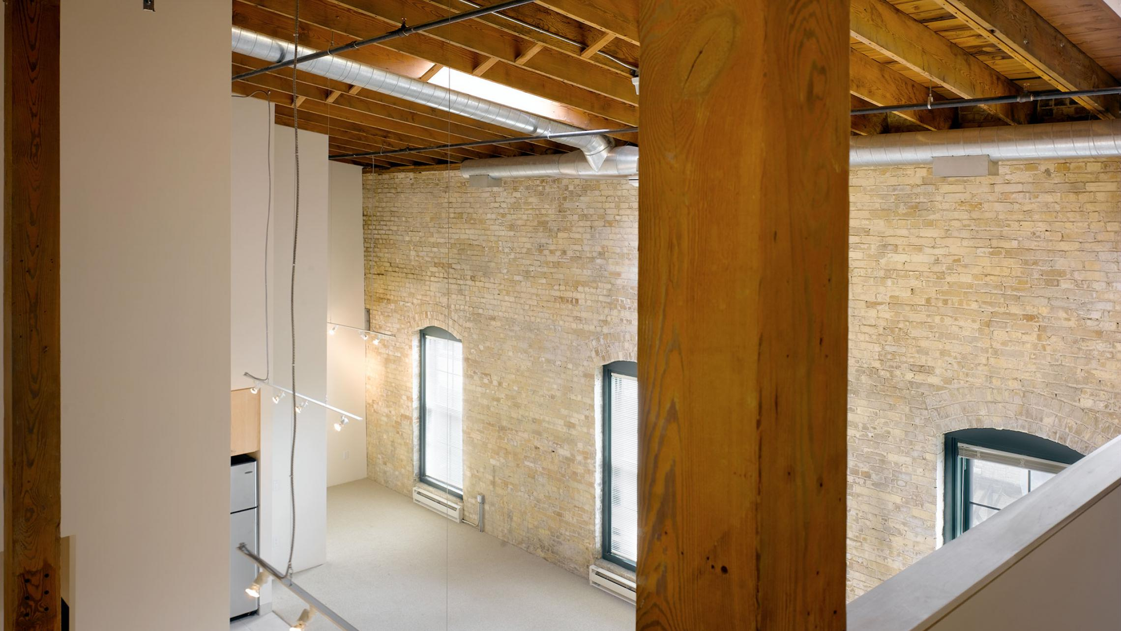ULI Tobacco Lofts Apartments - Loft View with Exposed Wood Beams