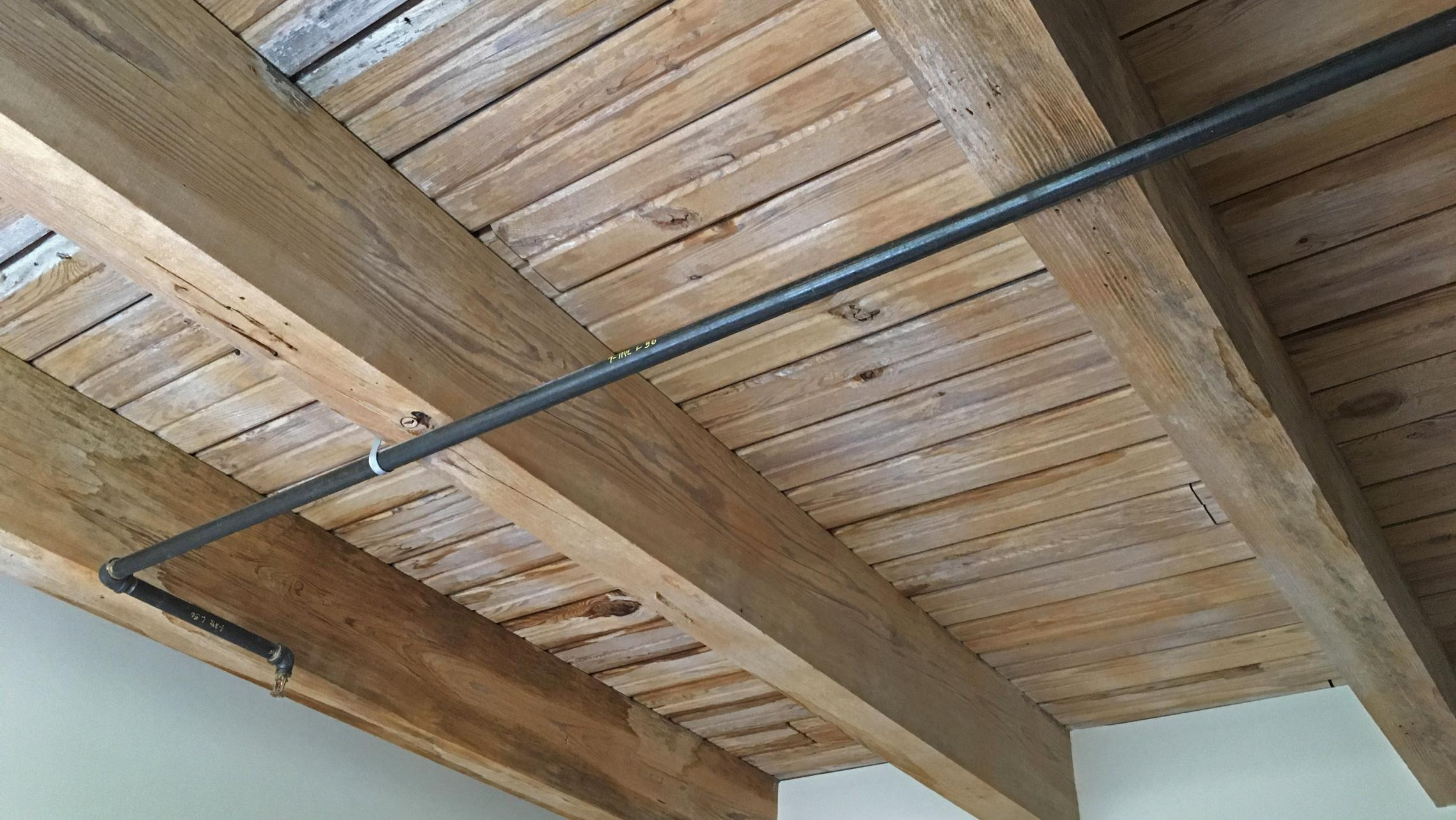 ULI Tobacco Lofts - E104 - Ceiling with Exposed Wood Beams