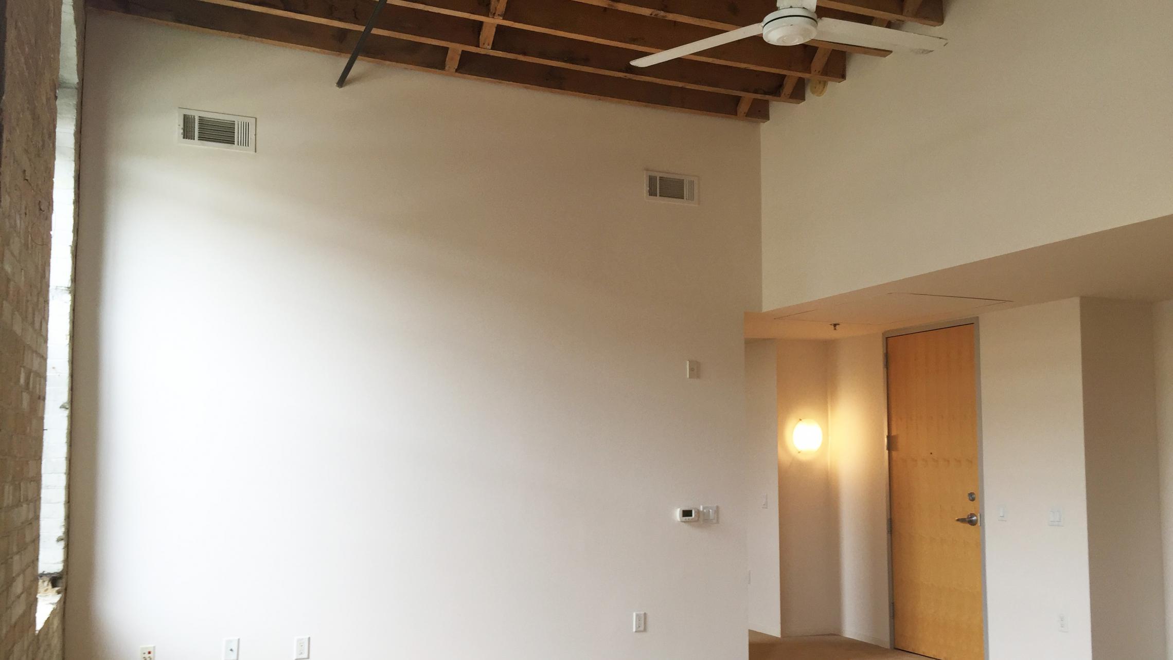 ULI Tobacco Lofts - E208 - Living Area with Historic Touches