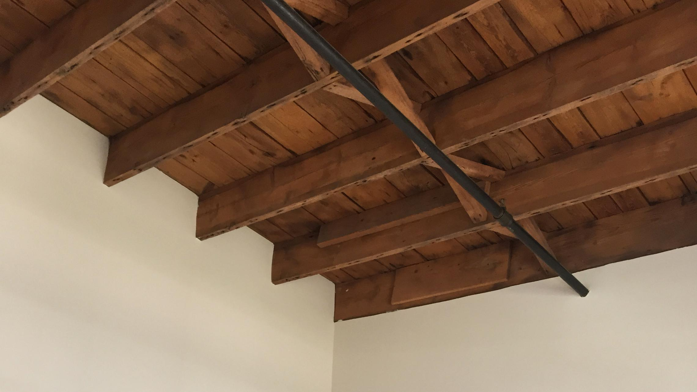 ULI Tobacco Lofts - E309 - Ceiling with Exposed Wood Beams
