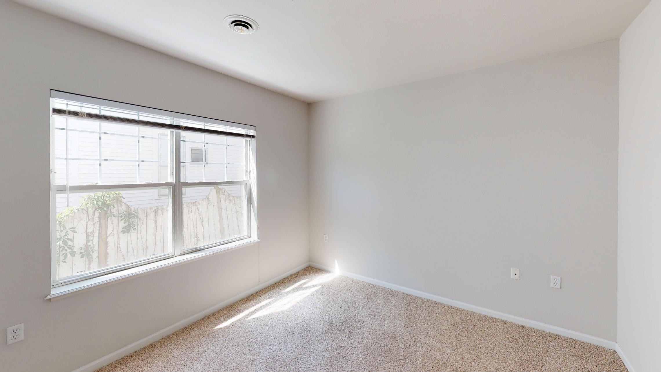 Wilson-Bay-Apartment-112-Two-Bedroom-Downtown-Madison-Guest-Room-Balcony-Corner.jpg