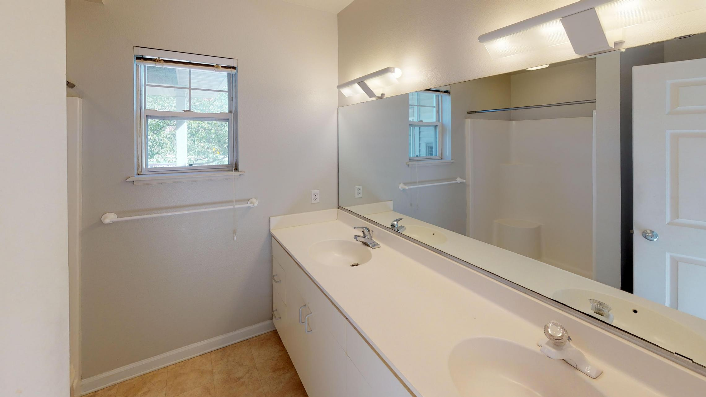 Wilson-Bay-Apartment-112-Two-Bedroom-Downtown-Madison-Master-Bathroom-Double-Sinks-Corner-Window.jpg