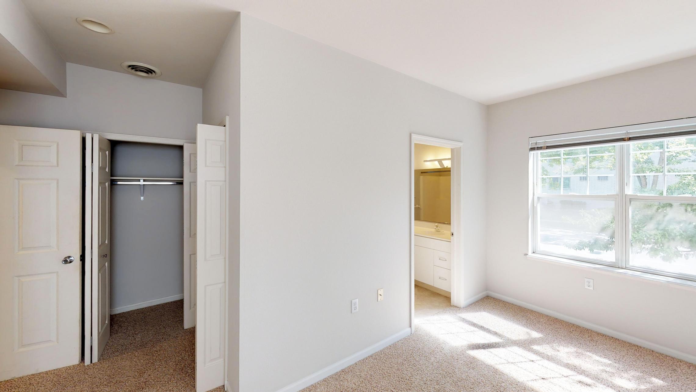 Wilson-Bay-Apartment-112-Two-Bedroom-Downtown-Madison-Master-Bedroom-Closet-Bathroom-Corner-Natural-Light.jpg